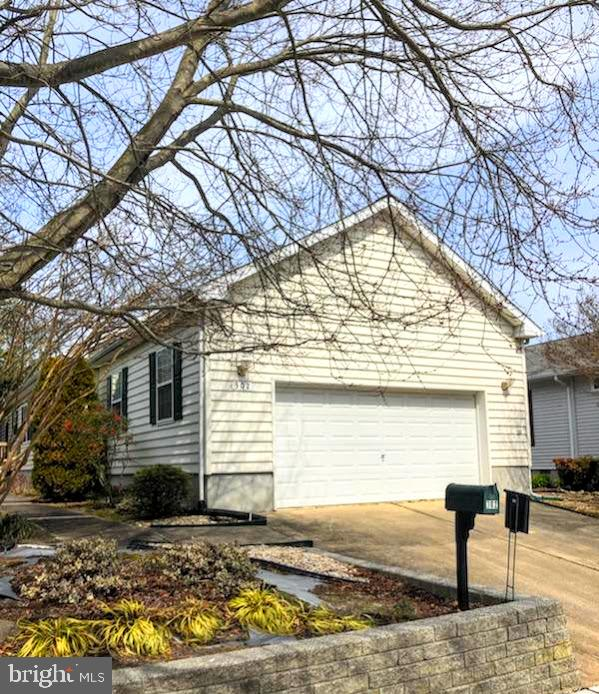 Enjoy one level living in this 3 bedroom, 2 bath rancher tucked among the trees in quiet Caine Woods