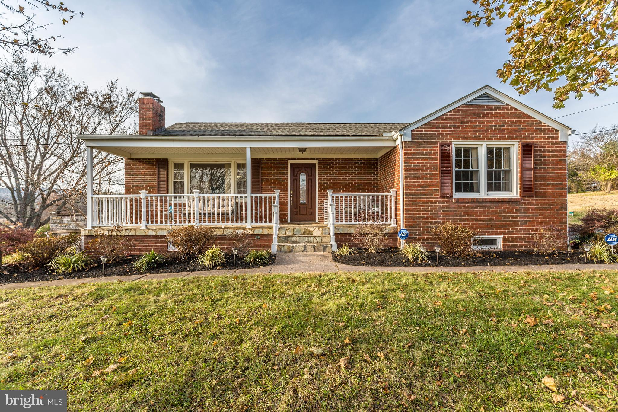 Back on the market! Charming all brick rambler with rear circular drive on 1 acre. Recent renovation