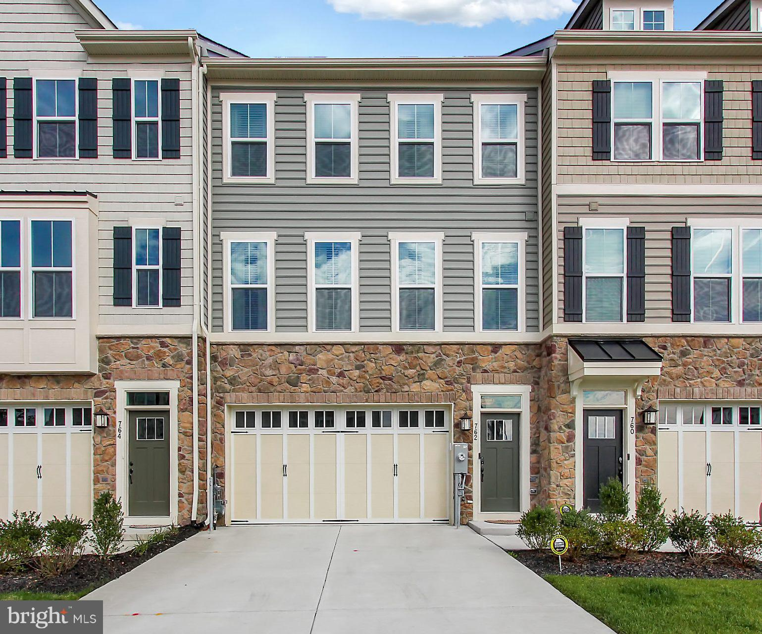 You'll fall in love with  this gorgeous townhome  just built by Ryan Homes in 2018. The homeowner br