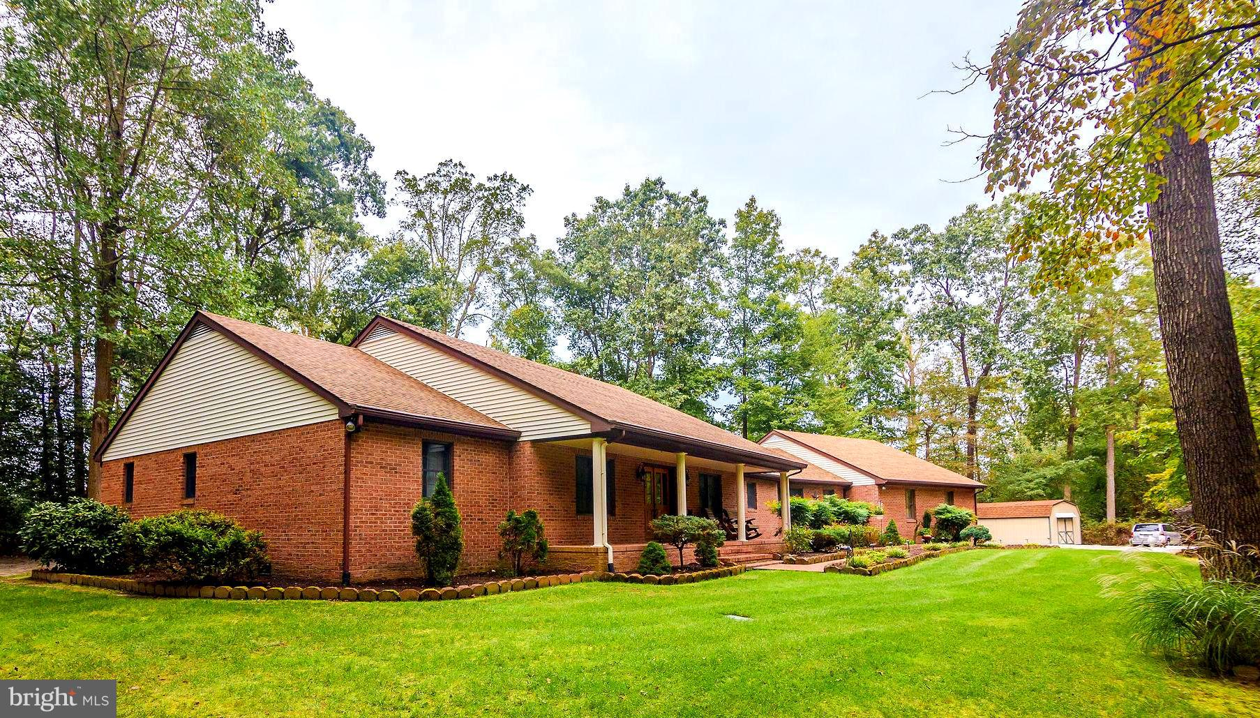 Pride of ownership and quality of construction shows in this all brick rancher with attached three c