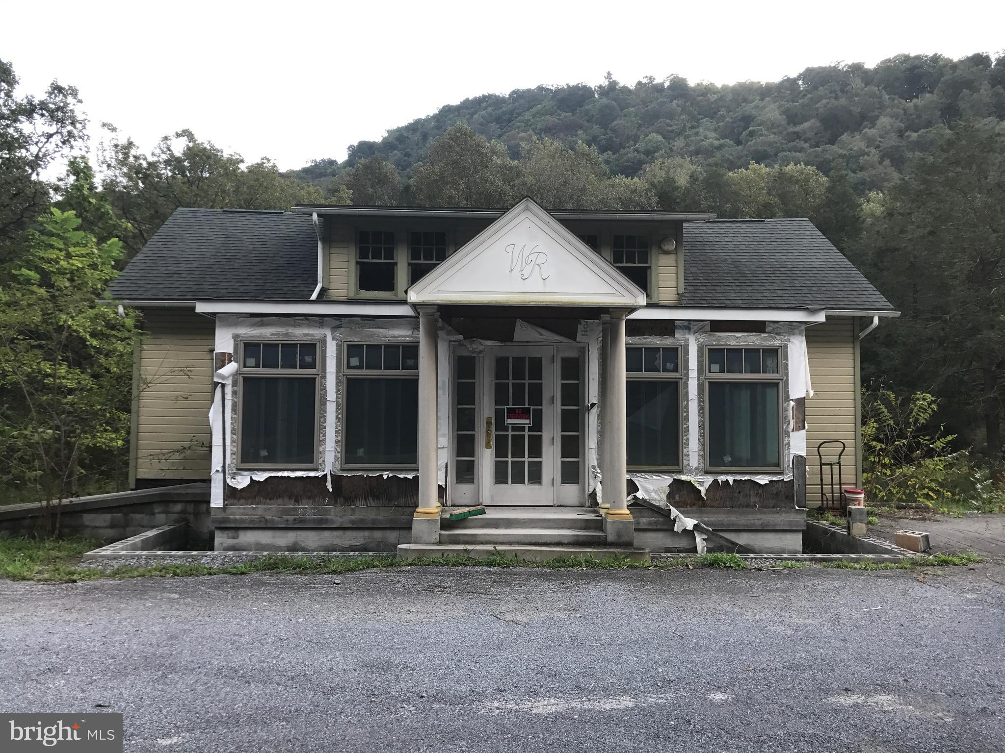 THIS PROPERTY IS GOING TO AUCTION ON 11/03/18 AT 11:00 A.M. THE LISTING PRICE IS A STARTING BID ONLY AND IS NOT INDICATIVE OF THE FINAL SALES PRICE. Approximately 7+/- acres with a commercial building that has been partially remodeled. Interior needs to be completed but has some newer restaurant equipment already inside. Property has septic and well. Potential for commercial use. Property to be sold as-is. Adjacent 47 +/- acres will be sold at auction the same day. Road frontage along New Grenada Highway and has creek frontage. Owner financing available. Huntingdon County Tax ID numbers: 09-15-07 and 09/15/08 and additional Tax ID #08-12-07. Taxes are estimated. Property is actually in Southern Huntingdon School District. Terms: $10,000.00