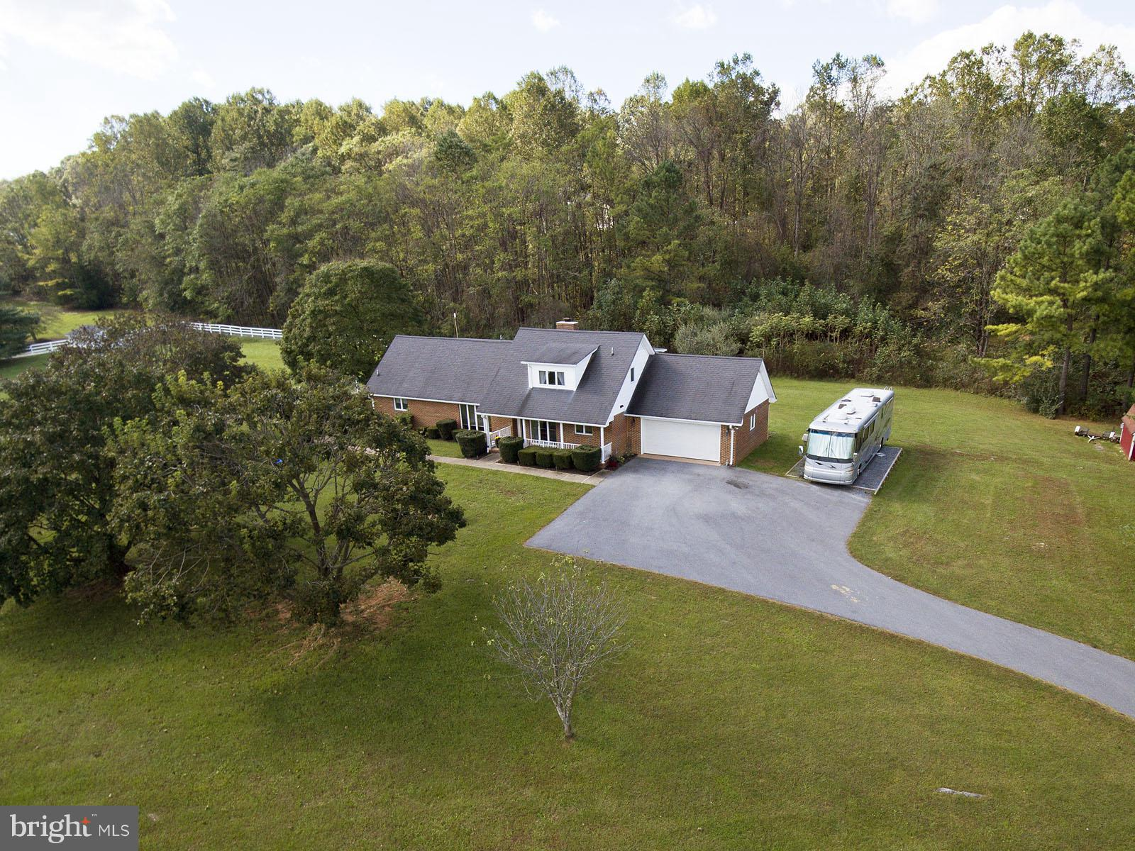 Country living on 5 acres! Wait until you drive up this tree lined driveway to your new home. Beauti