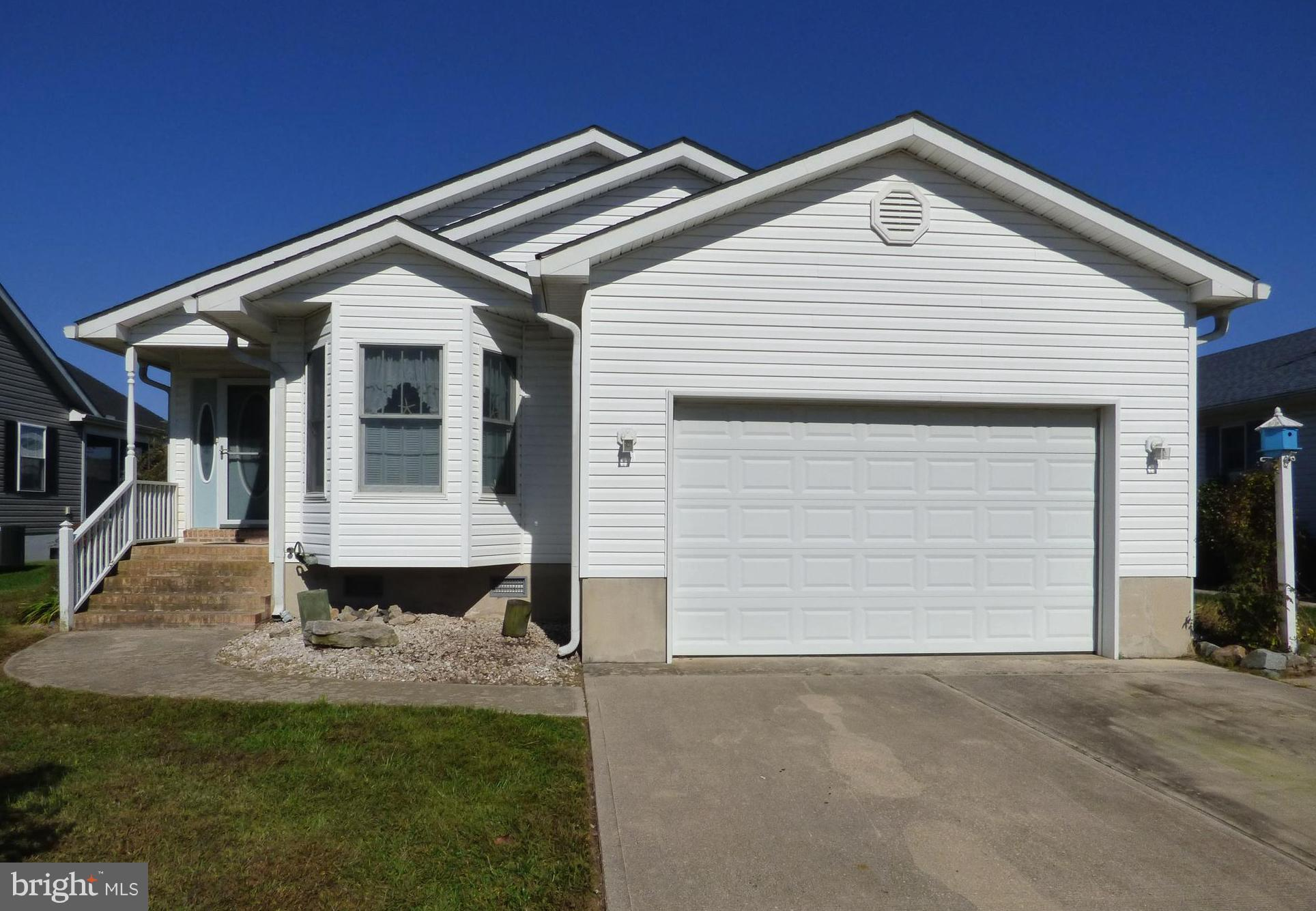Enjoy easy one level living in this coastal ranch style home featuring 3 bedrooms, 2 full baths, eat