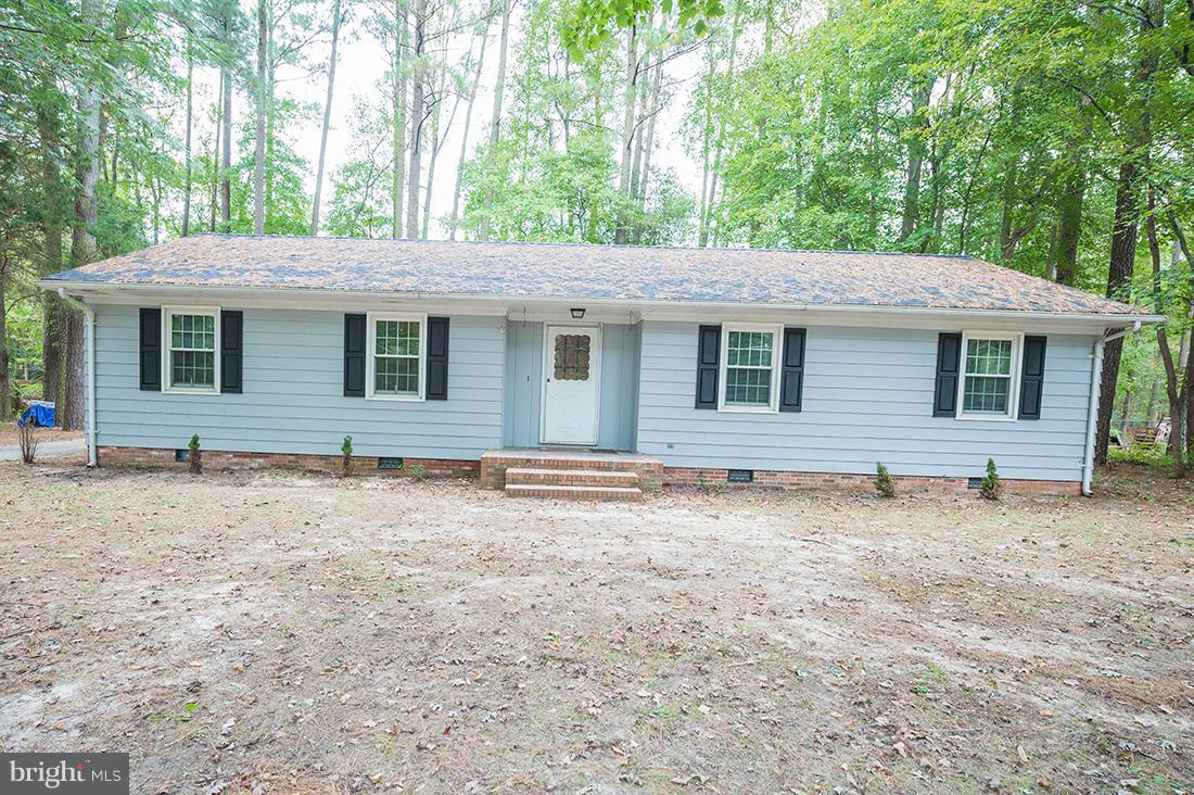 Check out this beautiful rancher, sitting just outside city limits, on a large partially wooded lot!