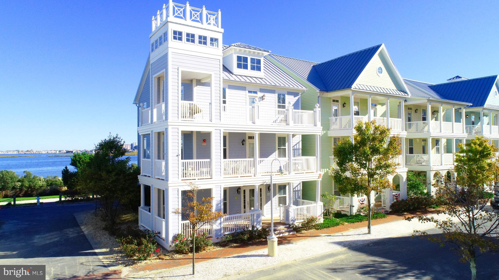 This gracious 5 bed, 4 1/2 bath, coastal design offers stunning open bay views, lovely wrap around b