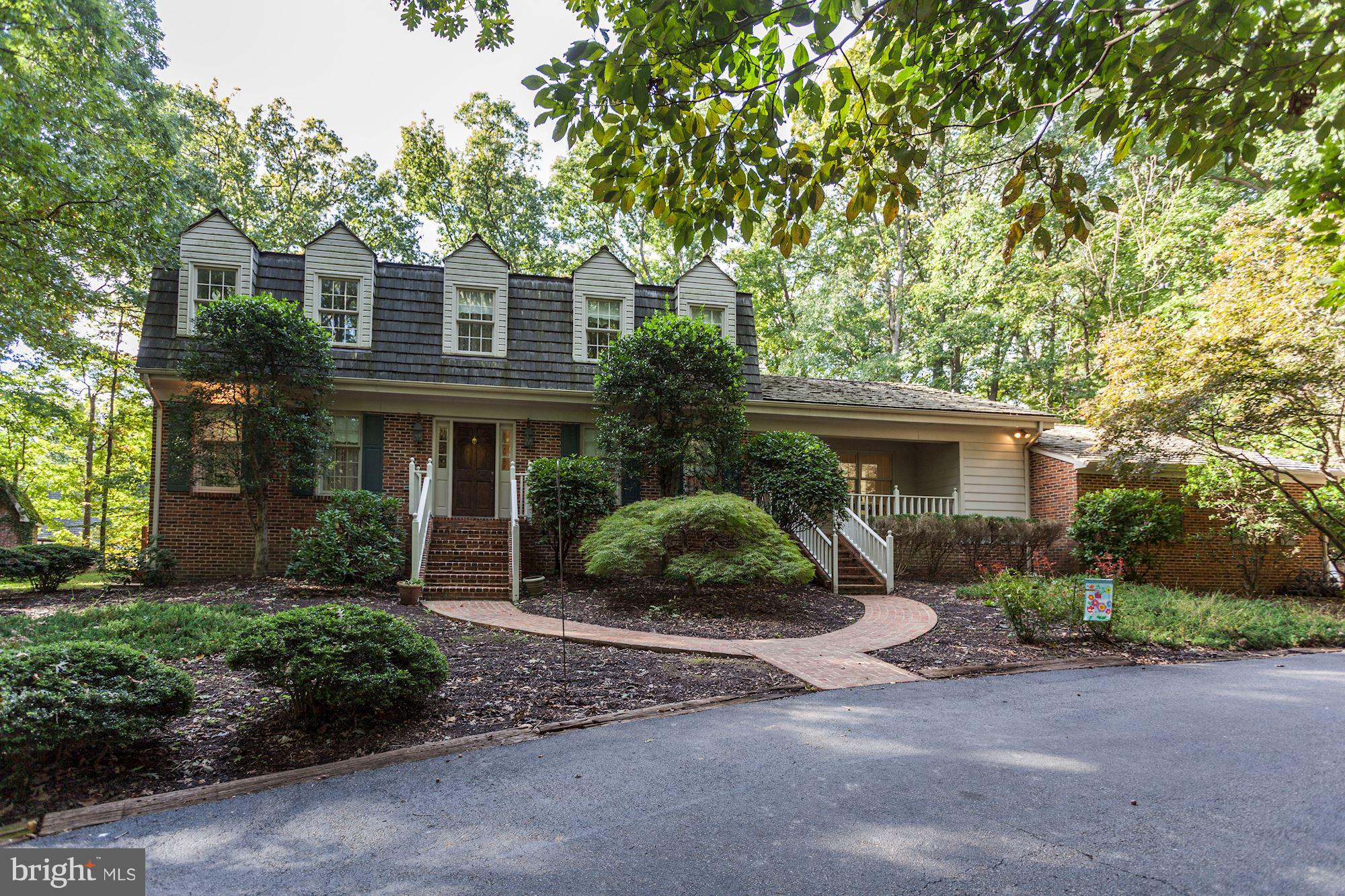 CHARMING COLONIAL ON BEAUTIFUL CORNER LOT WITH TONS OF PRIVACY, GORGEOUS HARDWOODS, 2 WOOD BURNING F