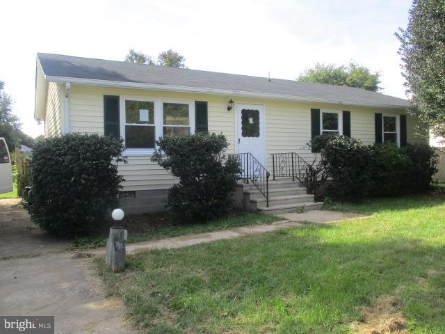 Cloverfields move in condition updated ranch with full length rear deck that overlooks large, level