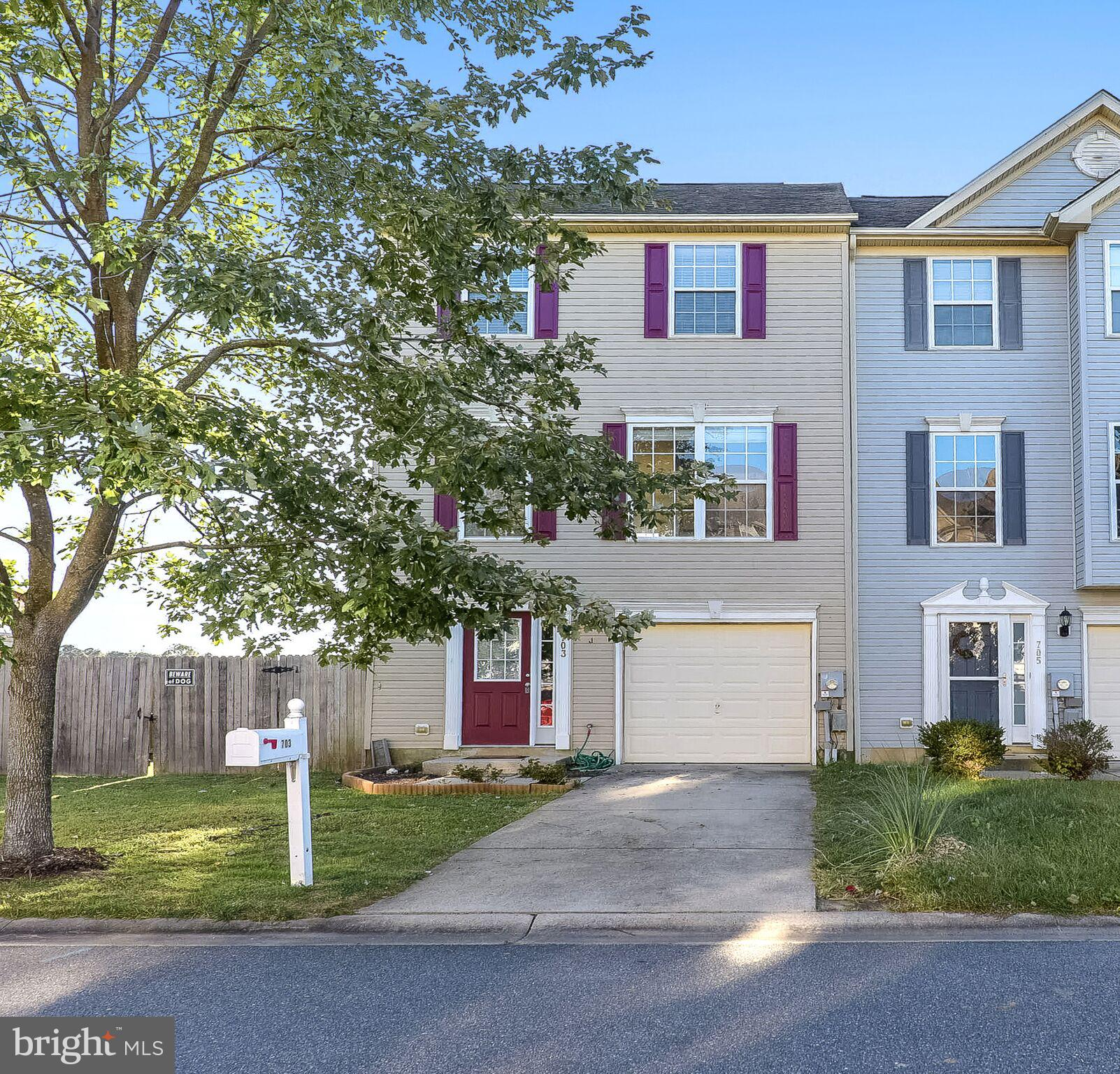 Nice! End unit, 3 story townhouse, lots of space in this 3 bed 1 full bath 2 half bath home with an