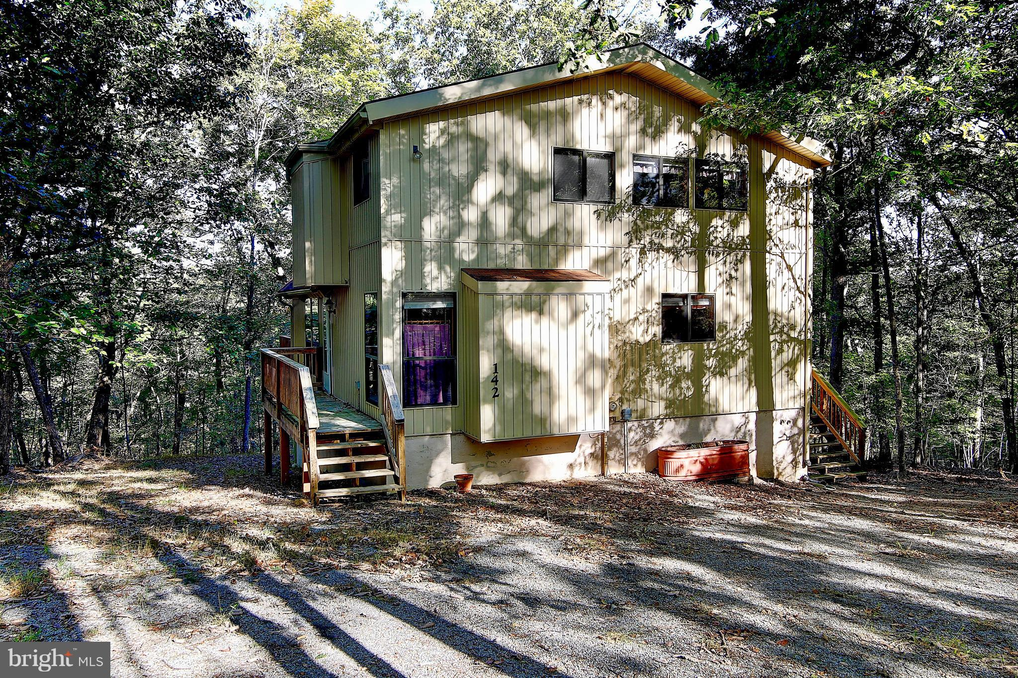 Cozy Chalet tucked away in private setting, has been very well maintained. Open floor plan. Master b