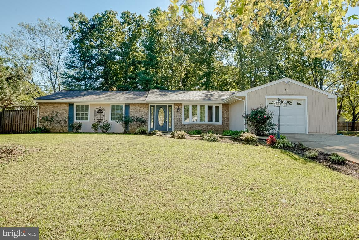 **THIS BEAUTIFUL RAMBLER IS A MUST SEE!!**  4 spacious bedrooms, 2 bathroom rambler style home with