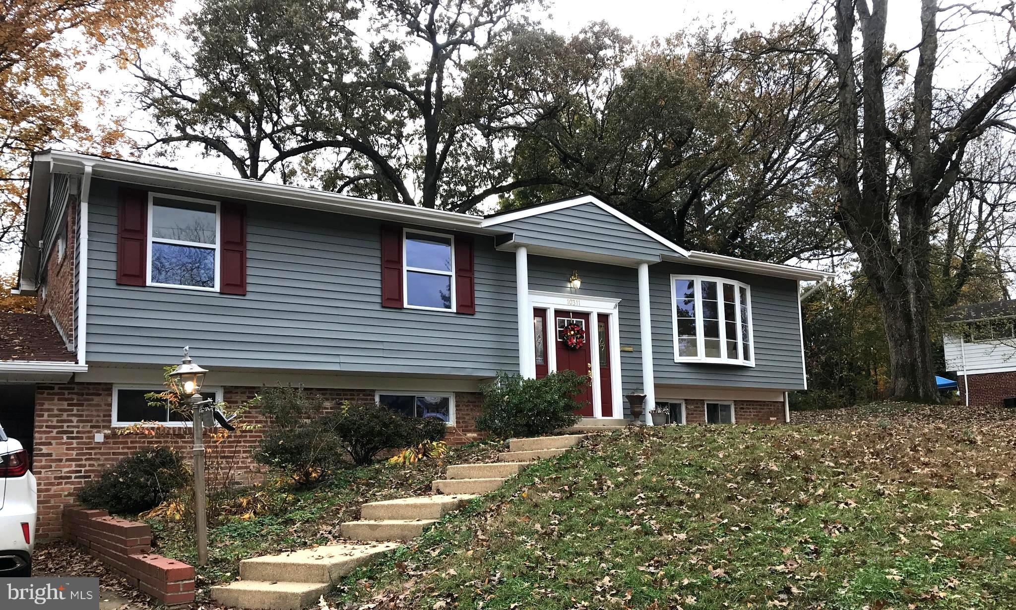 Stunning completely renovated home in the heart of Fairfax. Weathered gray stained hardwood floors,