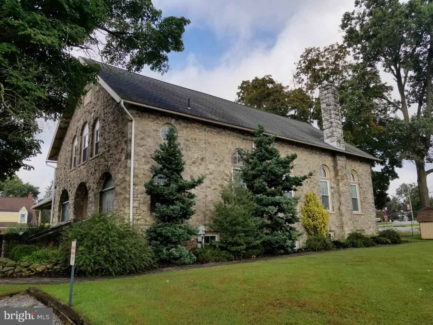 Well maintained and updated stone built church building on large corner lot ready for new ownership.  Handicap accessible into large sanctuary with sound system space, gas fireplace & wood paneled ceiling.  Features include large updated kitchen on lower level, with multiple classroom/social rooms, nursery room; 2nd floor meeting rooms & office.  Separate M/F restrooms on lower level & storage closets with outside entrance.  Newer carpet and paint, multiple zoned heat system, carport with new roof in 2017, all windows new in 2016, updated heating/AC system in 2007.  Zoning allows opportunity, buyer to check with township.