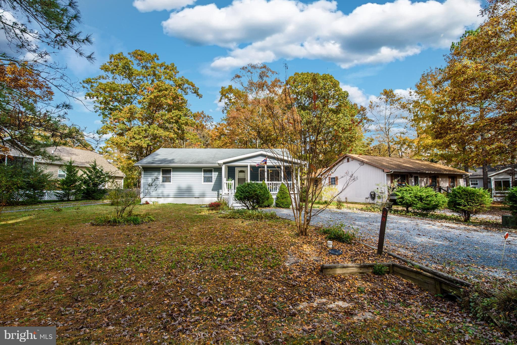 Major Price Adjustment and Absolutely beautiful 3 bedroom, 2 bath home nestled in Ocean Pines is Move In Ready and available for immediate purchase.  The one owner occupied home meticulously and lovingly cared for home features and inviting open front porch , new laminate hardwood floors were done  in 2016 includes Living Room,  Dining Room, Kitchen, Sun room , Den and Hallway.  Newer carpets in all 3 bedrooms and both bathrooms have been update with new vanities and flooring, Master Bath features tub shower combination.   Heat Pump was replaced in 2012 as well as appliances, hot water heater and washer and dryer.  The Roof was replaced in 2005 when the sun room and den was added to the home.  Private setting with oversize lot plenty of room to expand home further out, add a shed or fence in the backyard.  Plenty of Attic storage for year round living or perfect to store summer beach toys.  Parking is not a problem driveway will easily accommodate 4 to 5 cars or boat and trailer! Aggressively priced for current market conditions!! This home will not last long so don't want to schedule your private showing.