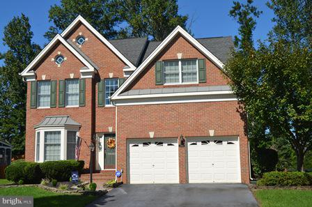 3 FINISHED LEVEL BRICK FRONT COLONIAL *  GOURMET KITCHEN * FAMILY ROOM WITH FIREPLACE * MAIN LEVEL OFFICE * MASTER SUITE WITH SITTING ROOM & LUXURY BATH * 3 ADDITIONAL  SPACIOUS BEDROOMS AND 2 MORE FULL BATHROOMS ON UPPER LEVEL * FULL FINISHED BASEMENT WITH REC ROOM , WET BAR, PLAY ROOM AND MEDIA ROOM * CUL DE SAC LEVEL LOT * DOMINION VALLEY AMENITIES