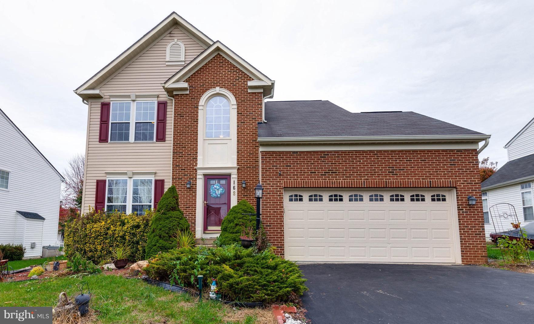 Gorgeous brick front Colonial in Breckenridge! Main level features hardwood floors, a large kitchen