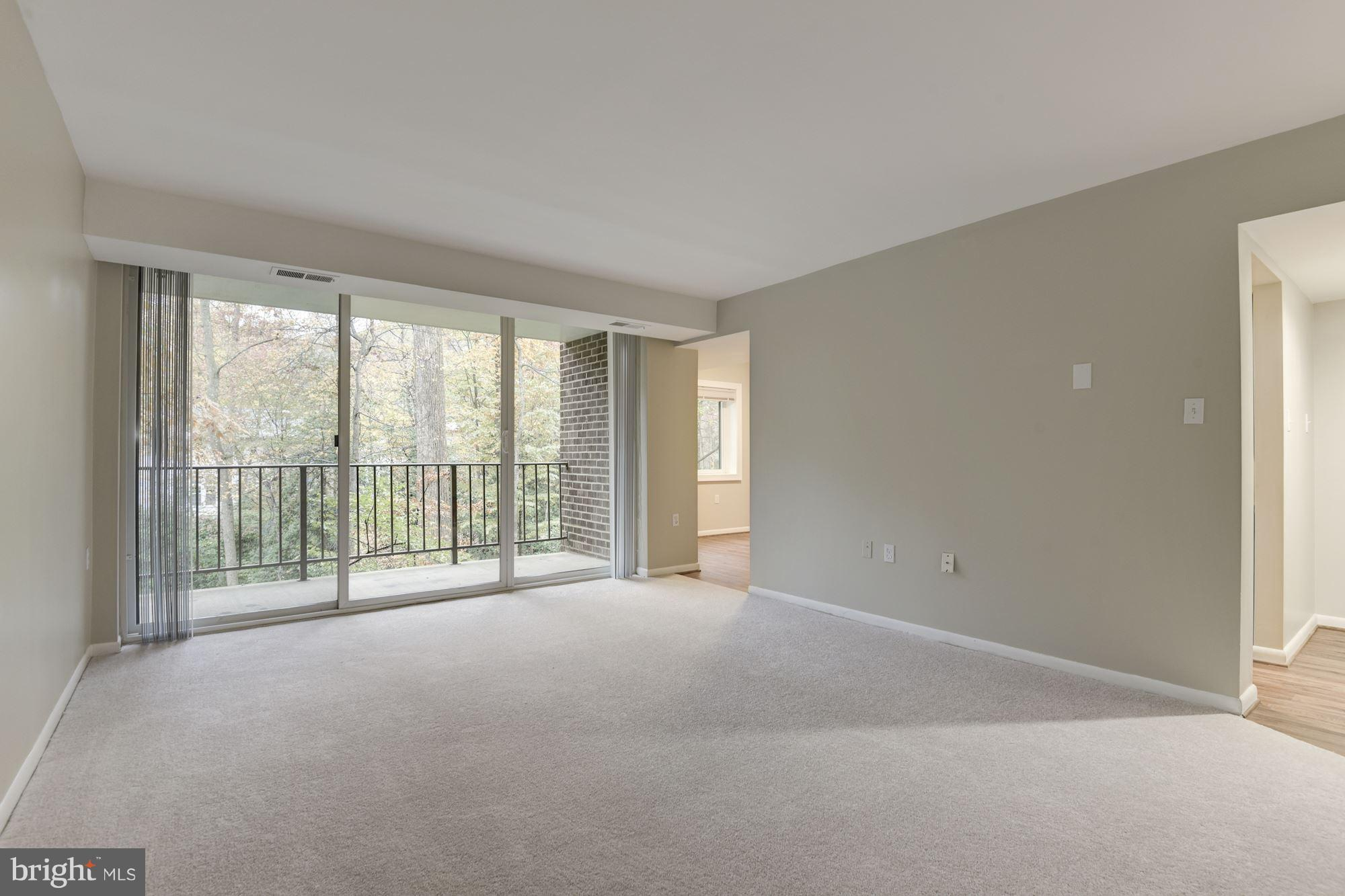 What a find! Gorgeous fully renovated corner unit with large balcony overlooking walking path and pa