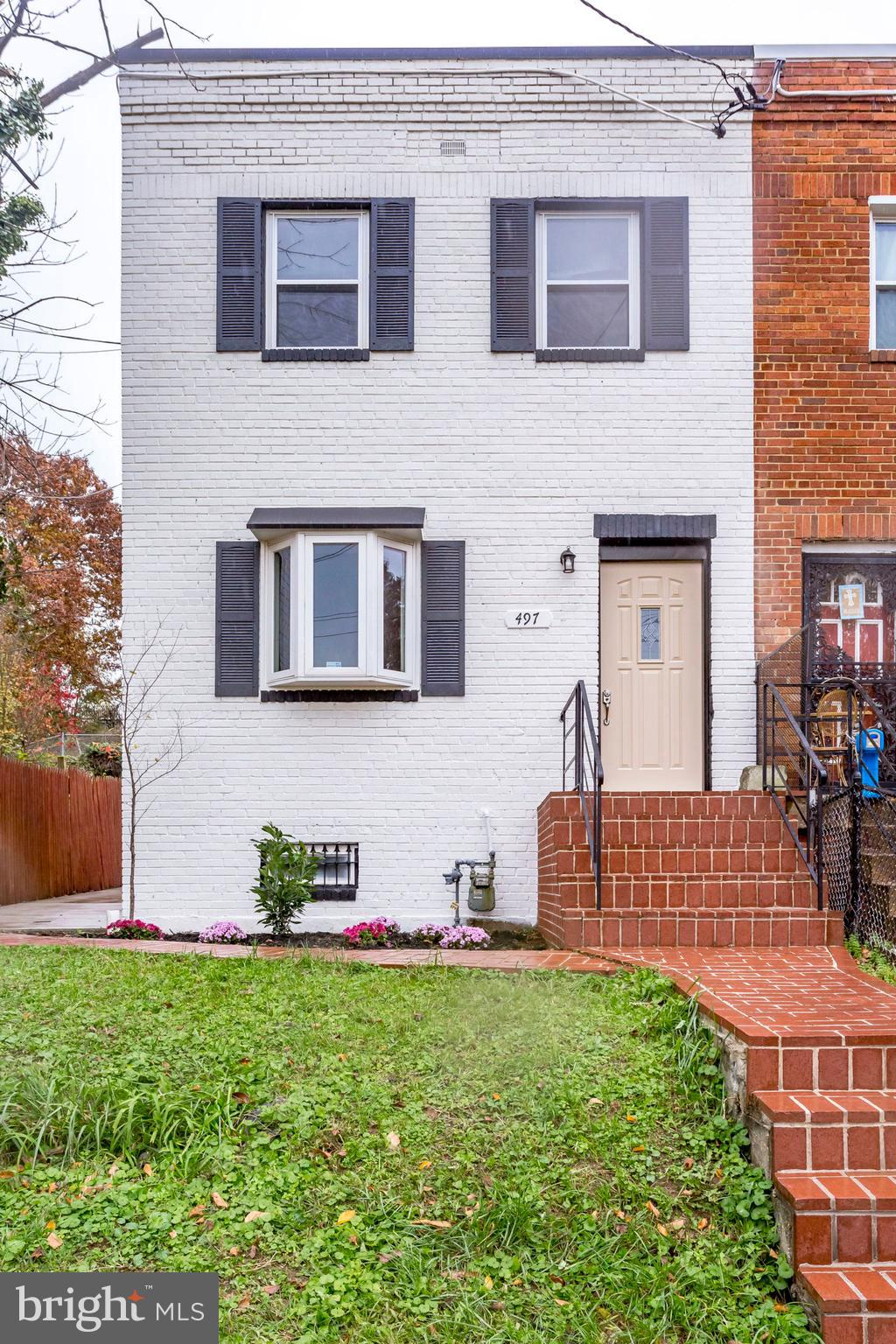 Beautifully renovated end unit row home! New Kitchen, New bathrooms, New HVAC, New Roof and so much