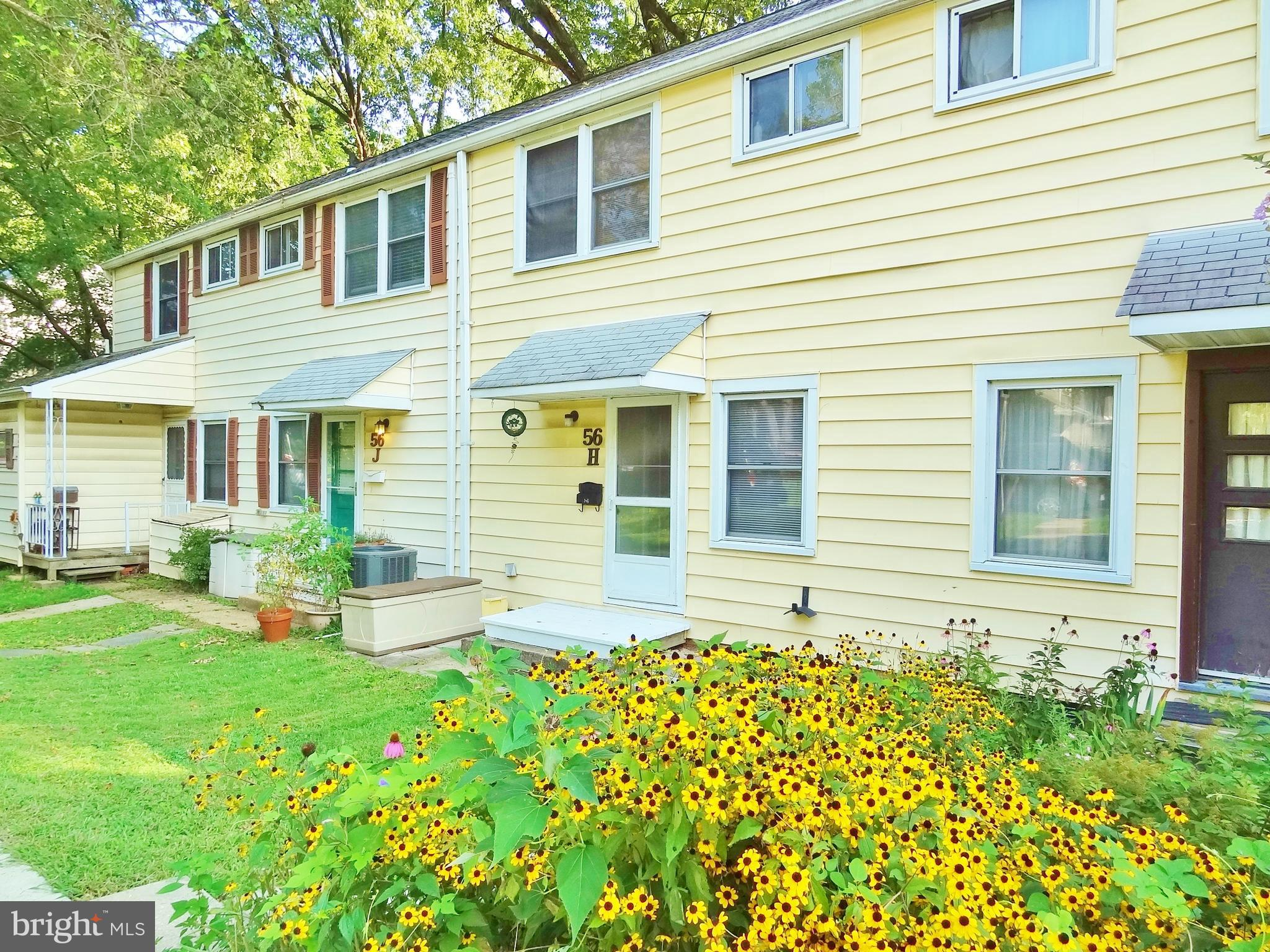 Remodeled GHI townhome with beautiful laminate flooring on main level.  Large, fenced backyard with
