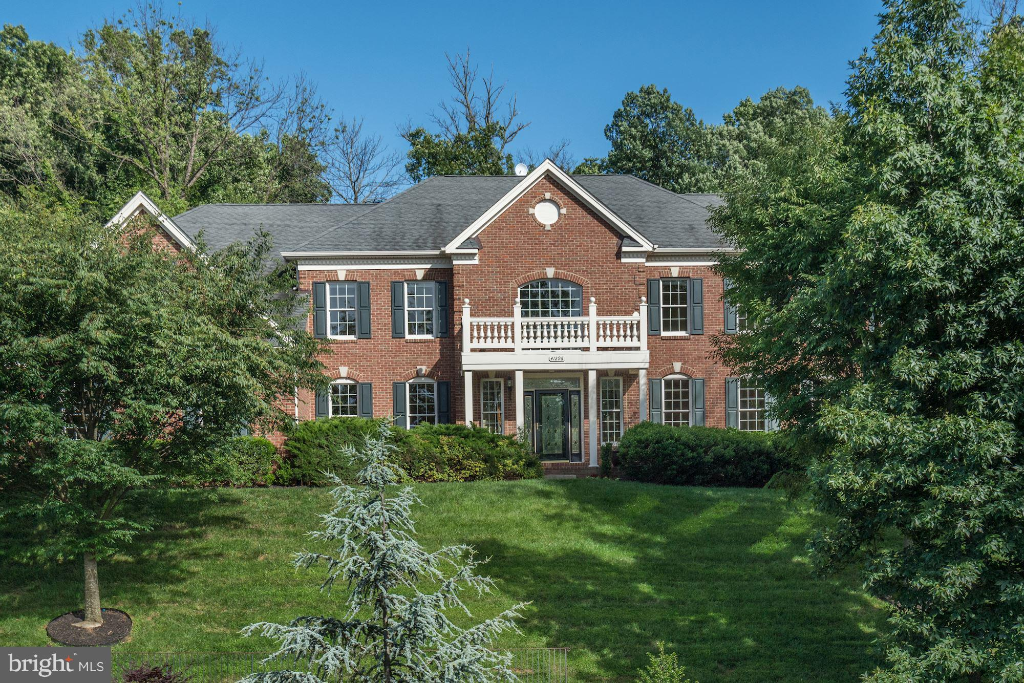 Amazing spacious Toll Brothers home in Waterford with private hilltop views from front. Large deck &