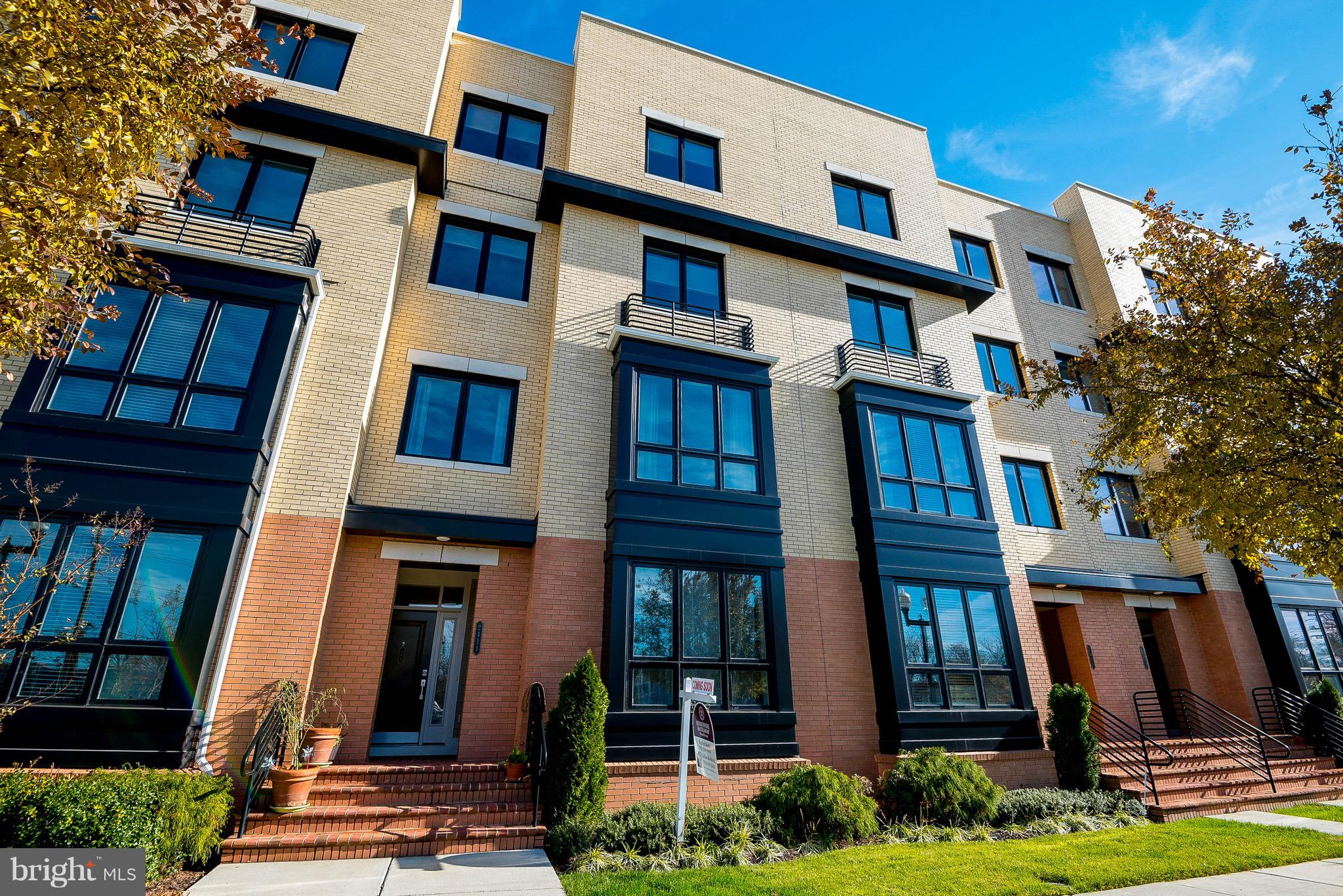 """Extraordinary 2 level modern style townhome/condo in the heart of Potomac Yard community ~ one of the largest model by Pulte - smart home wired- surveillance, heat/cool/lock & unlock & smart garage  with electric car charging station and custom overhead heavy duty storage racks - Abundant natural light, gourmet kitchen with upgraded cabinets & granite counters and glistening hardwood on main level and carpet on upper.  Spacious MBR with dual walk-in closet and spa bath & Roman shower with dual heads, double vanities, premium tile. upper laundry, floor to ceiling linen closet in masterbedroom & AMPLE STORAGE THROUGHOUT UNIT ~LOCATION, LOCATION, LOCATION!! - Metrobus Express Stop across the street,  10 blocks to Metro (2 stops to Crystal City and new metro at East Glebe has been approved!), 5 min from Old Town,  Walk to Potomac Yard shopping (Target, Michaels, restaurants, Petsmart, Staples, Giant, Kaiser Permanente),  quaint shops and pubs @Del Ray,  minutes to DCA airport and Pentagon City Mall. Bike path across street adds even more access to entire DC/NOVA/MD area (3 mi to Crystal City, future HQ for Amazon and """"VT Innovation Campus)."""