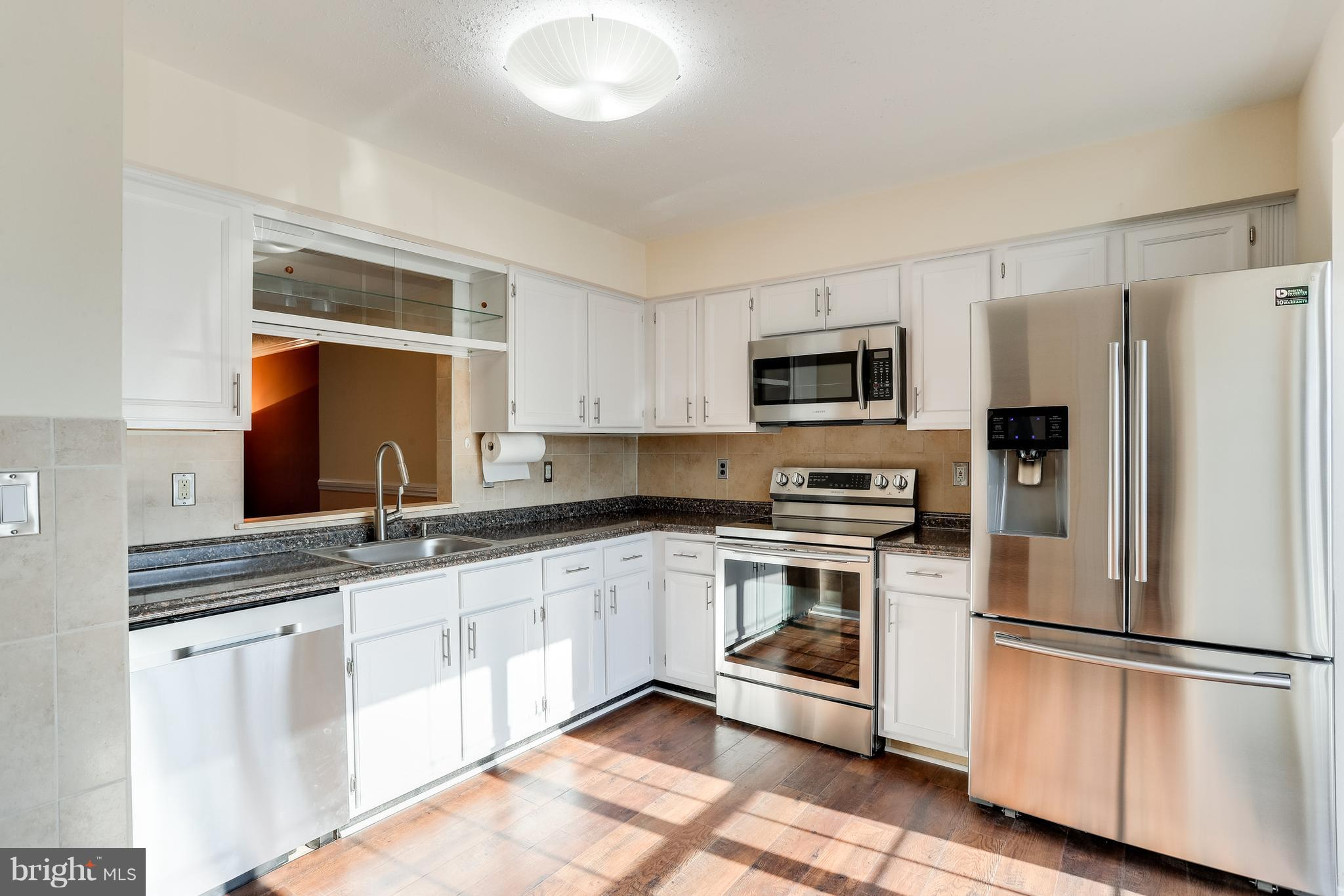 Beautifully Updated 3 Bedroom 2 Full Bath 2 Half Bath Townhouse with Special Designer Touches. Main