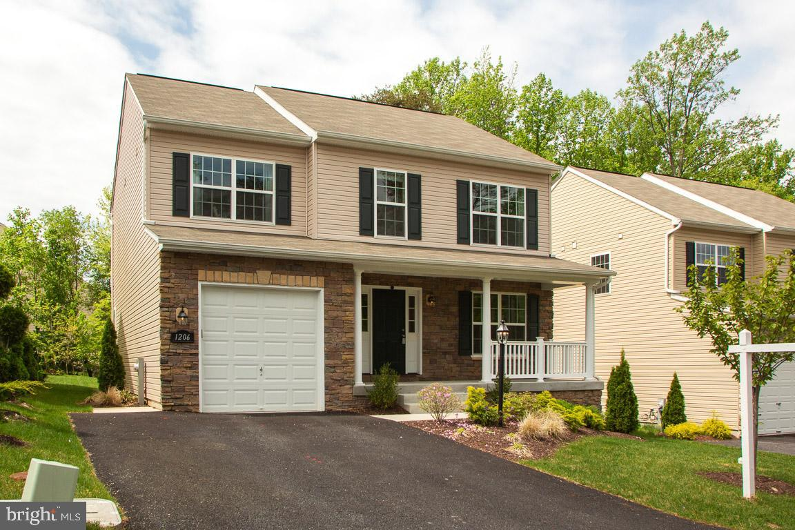 Nearly new home (2017) features four bedrooms, 2.5 baths, and sunny kitchen with wood cabinetry, sta