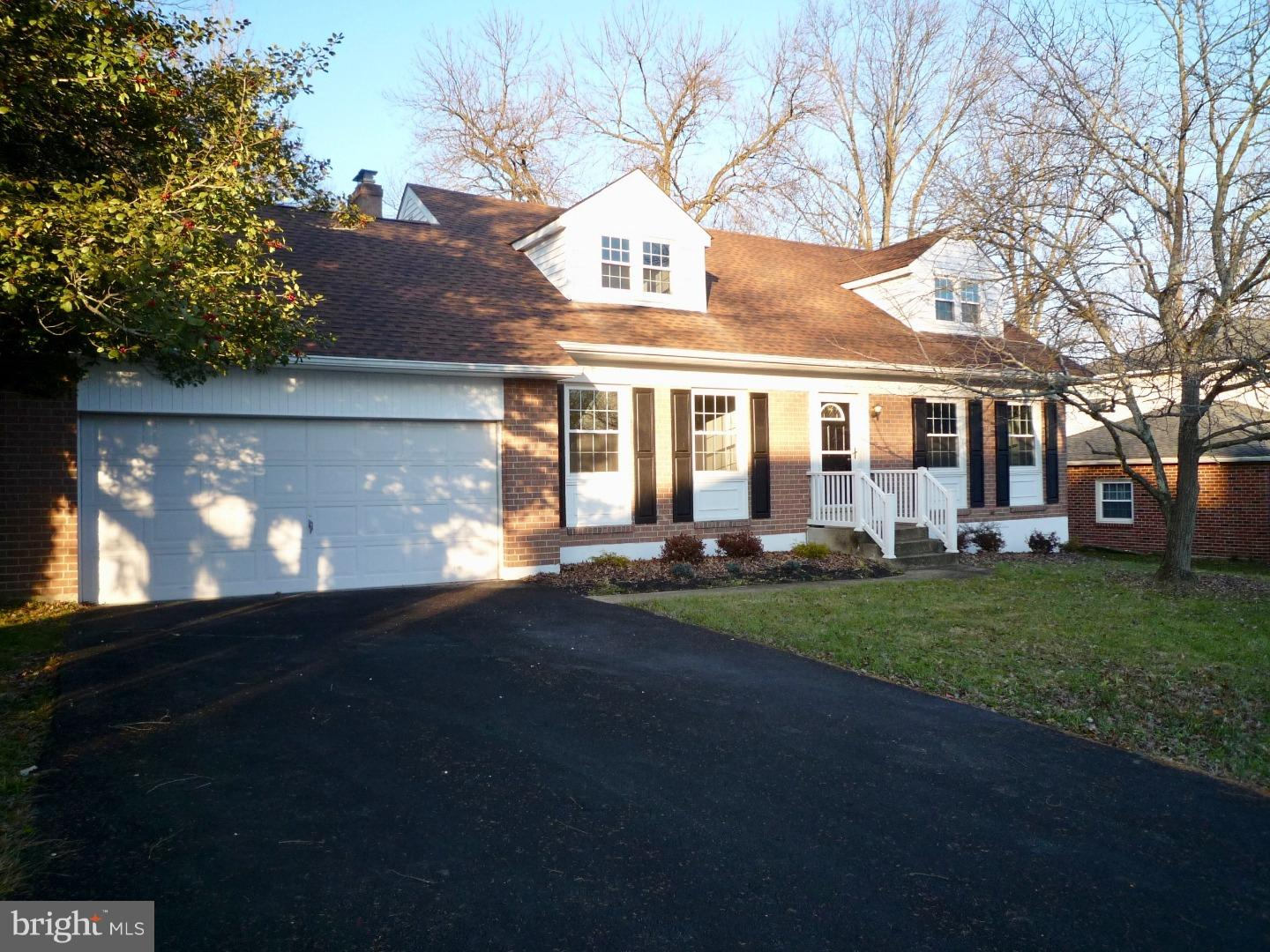 """Another """"STUNNING"""" renovation! This spacious,2-sty Colonial brick home w/ 4-5Brs/2.5Bas & 2-car gara"""