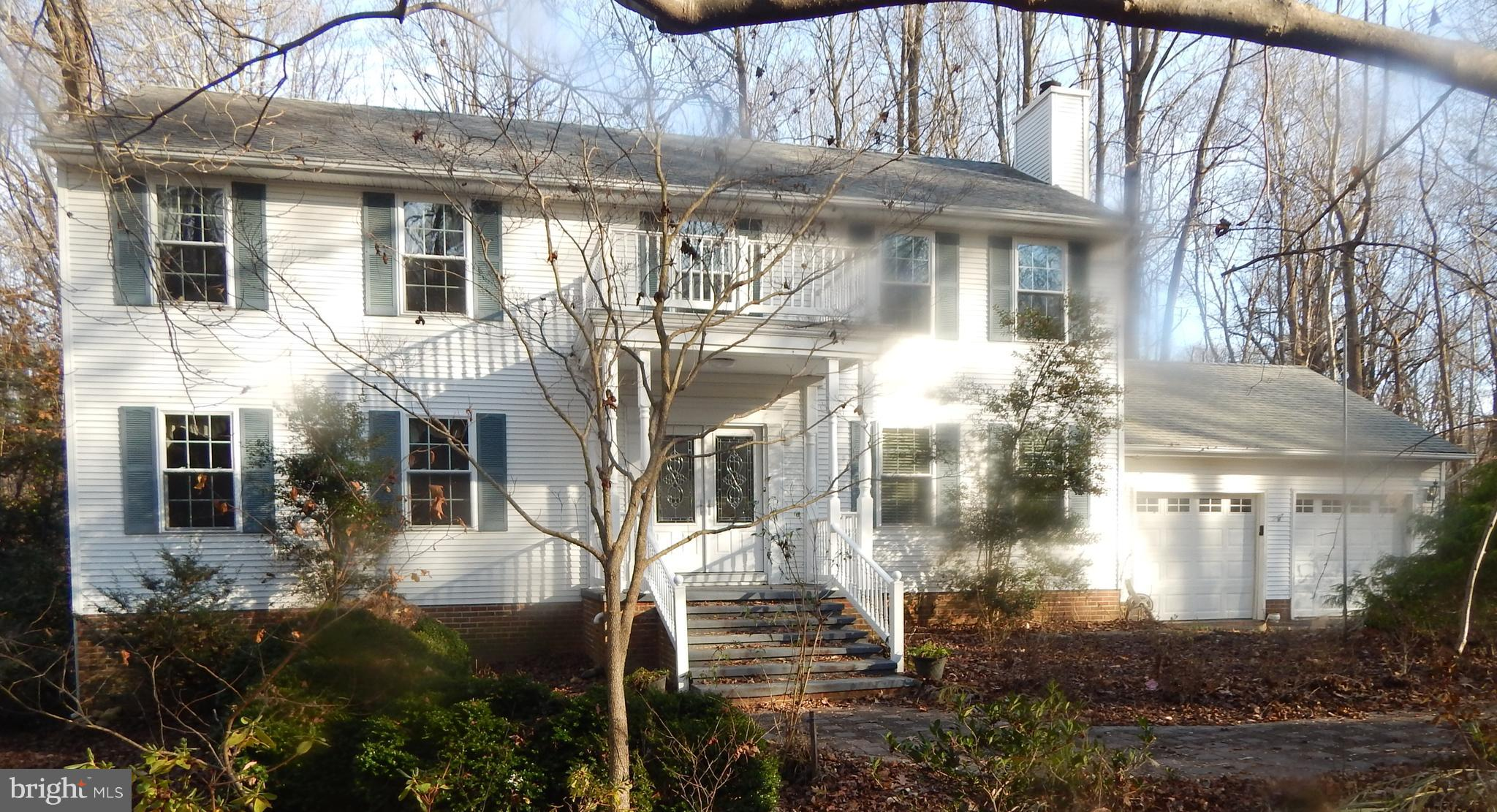 CSS GO AND SHOW! Beautiful Colonial situated in cul de sac on 1.10 acres, very private,no hoa, backs