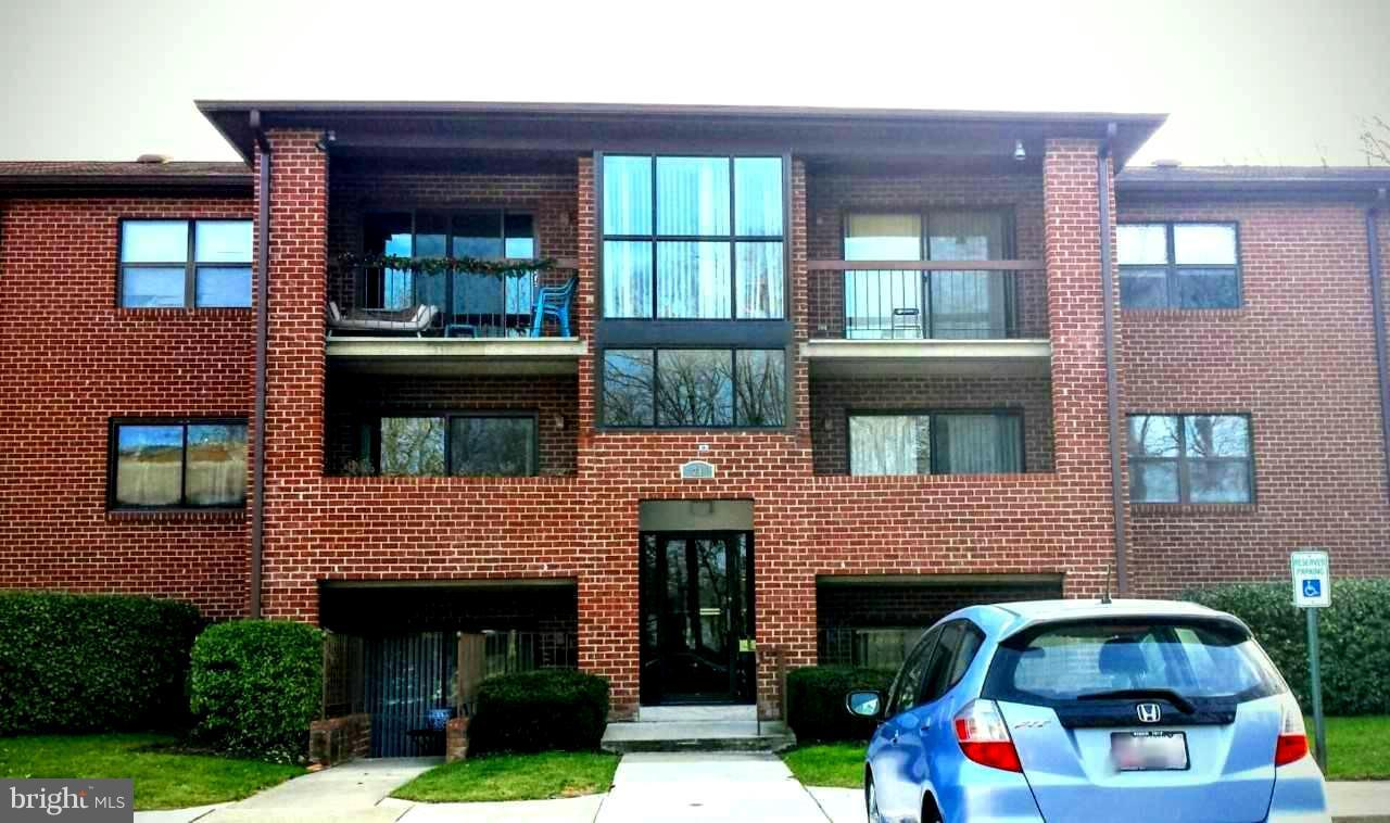 2nd Floor Condo with Front Balcony- Offering 2 Bedrooms, 2 Full Baths, Spacious Living Room with Sli
