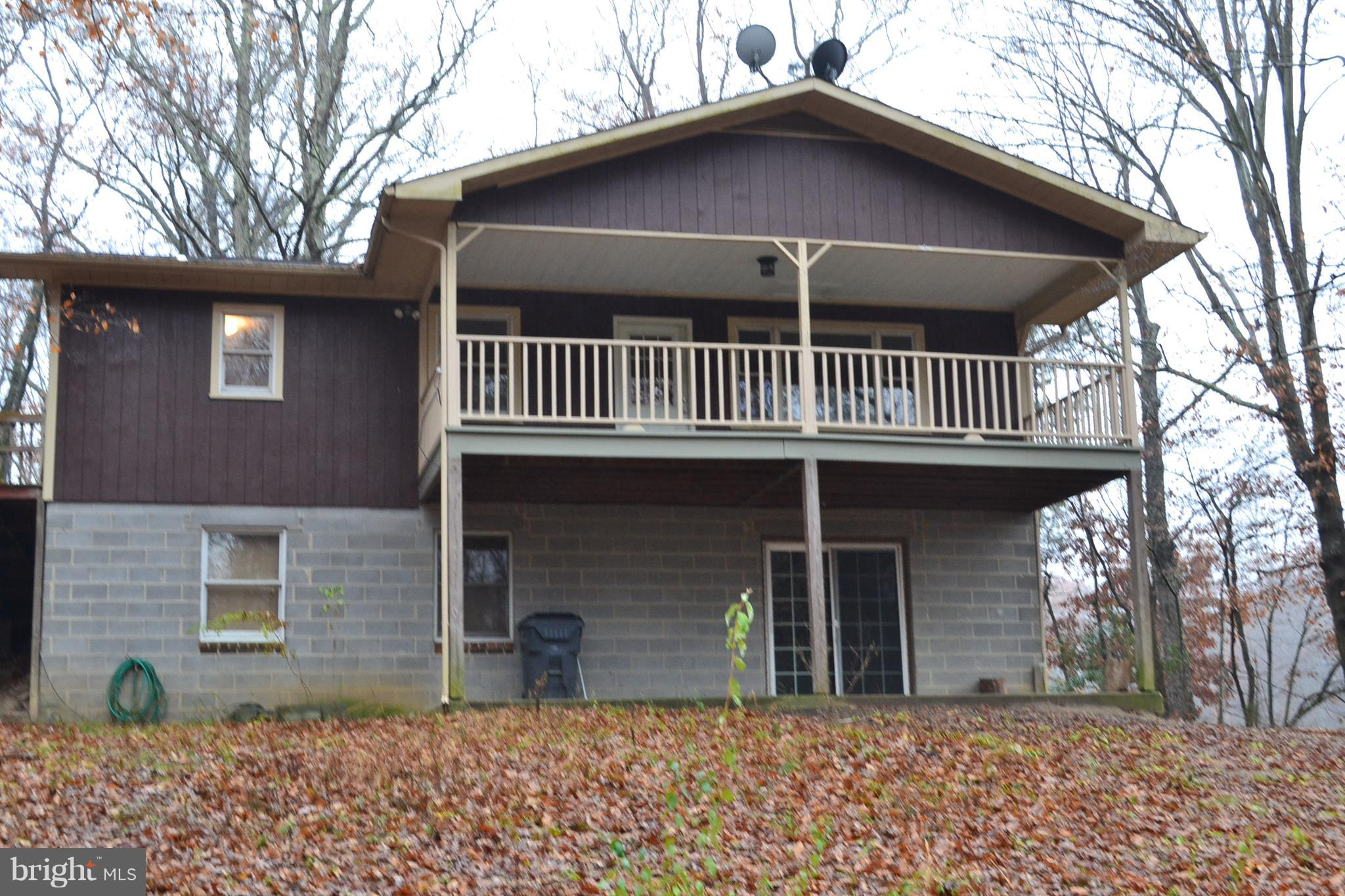 Country and convenience! 4 large bedrooms 3  baths.  Master bedroom with hardwood floors a full bath