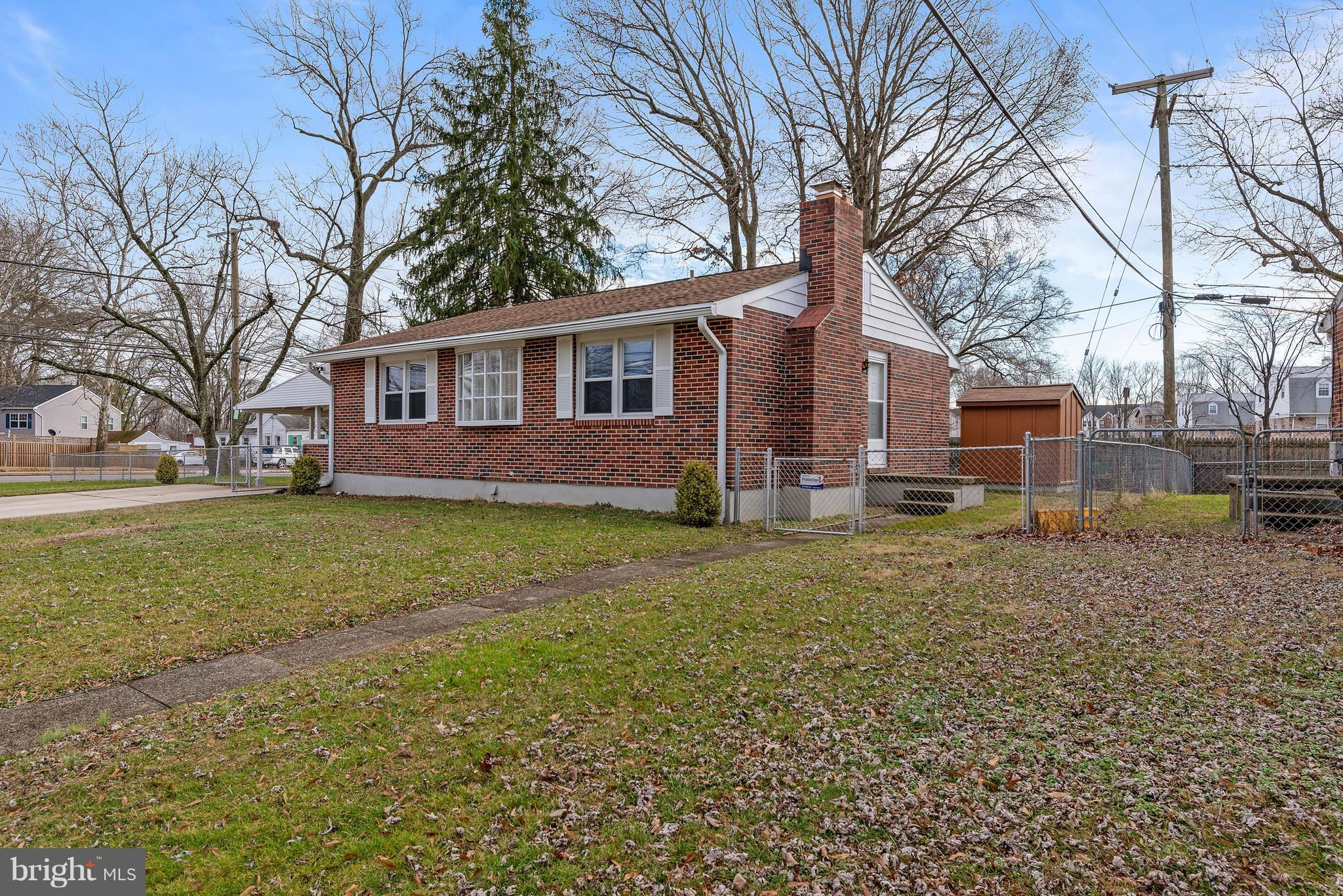 Brick rancher with carport, conveniently located near Route 100 for easy commuting!  Corner lot,  3