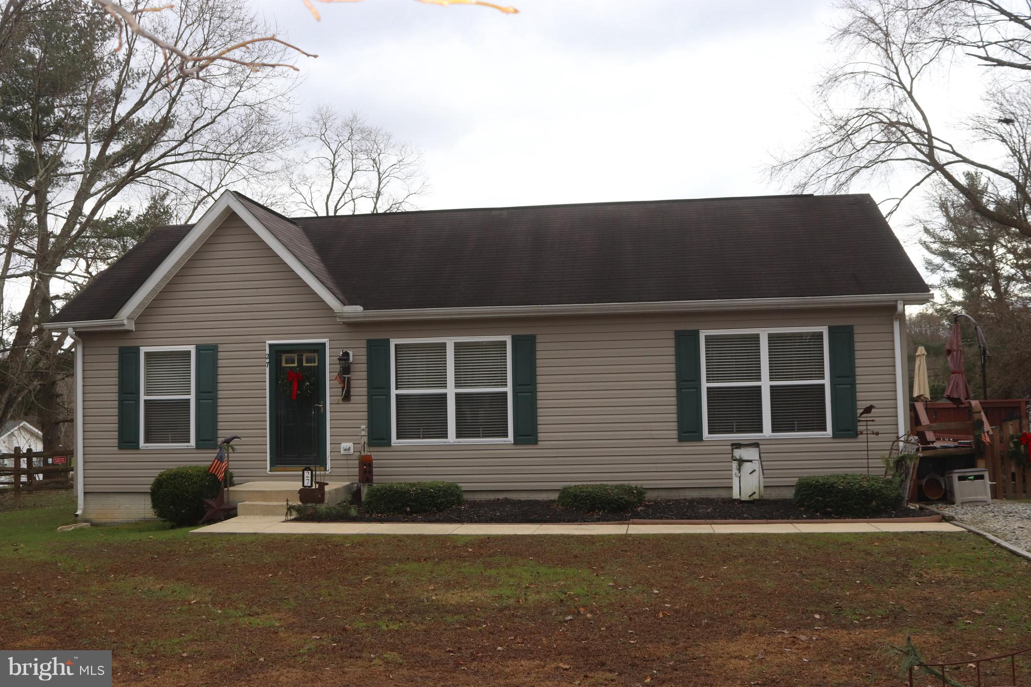 Come HOME for the holidays to this cozy rancher featuring three bedrooms and two full baths with a f