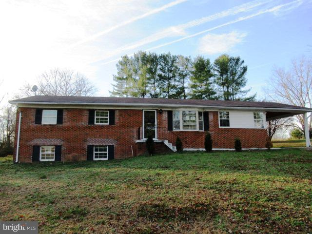 3 bedroom, 2 bath brick rambler on almost 2.5 acres with finished basement