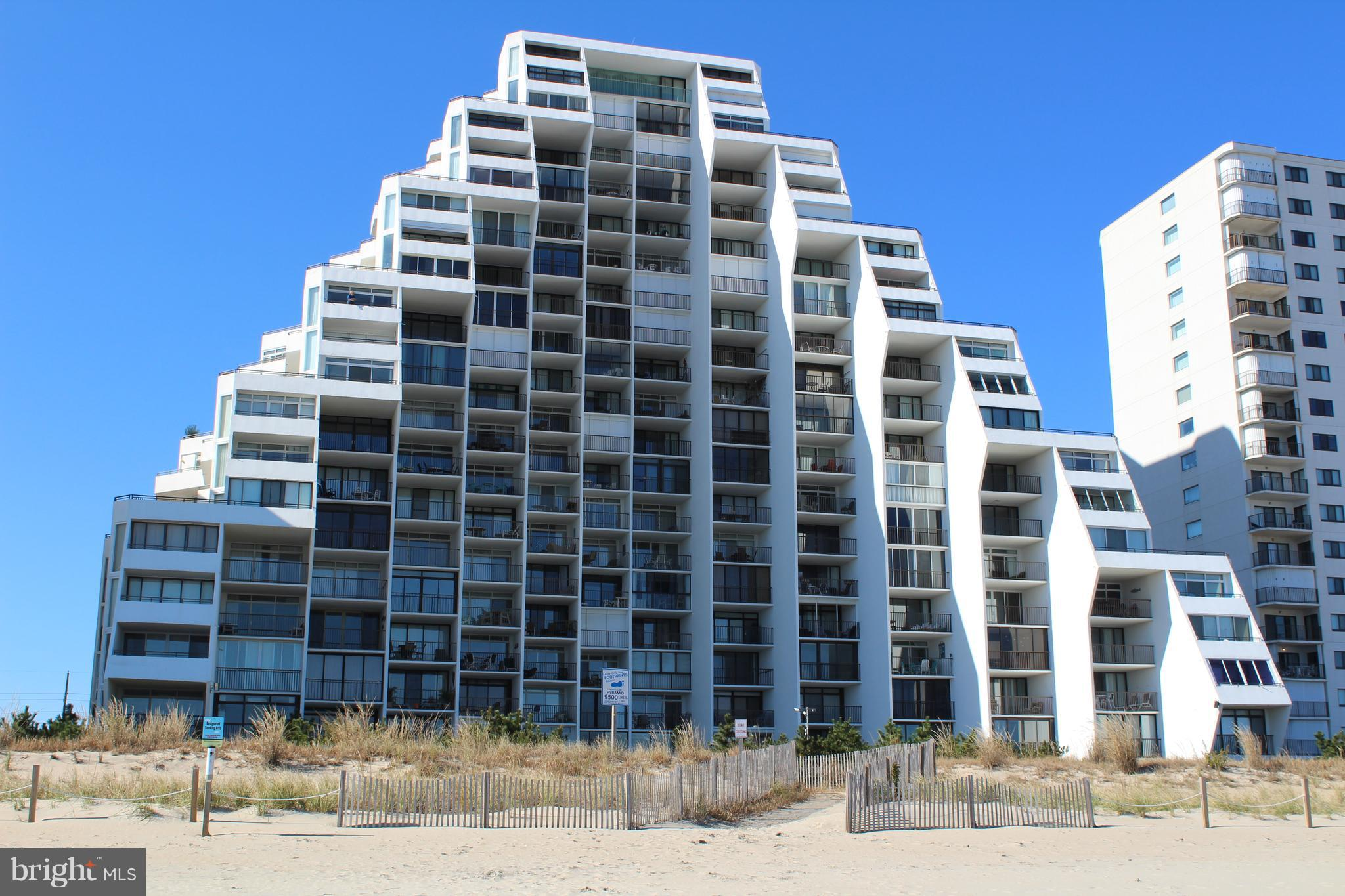 It's all about the spectacular views of the ocean and bay from this beautiful end unit with an incre