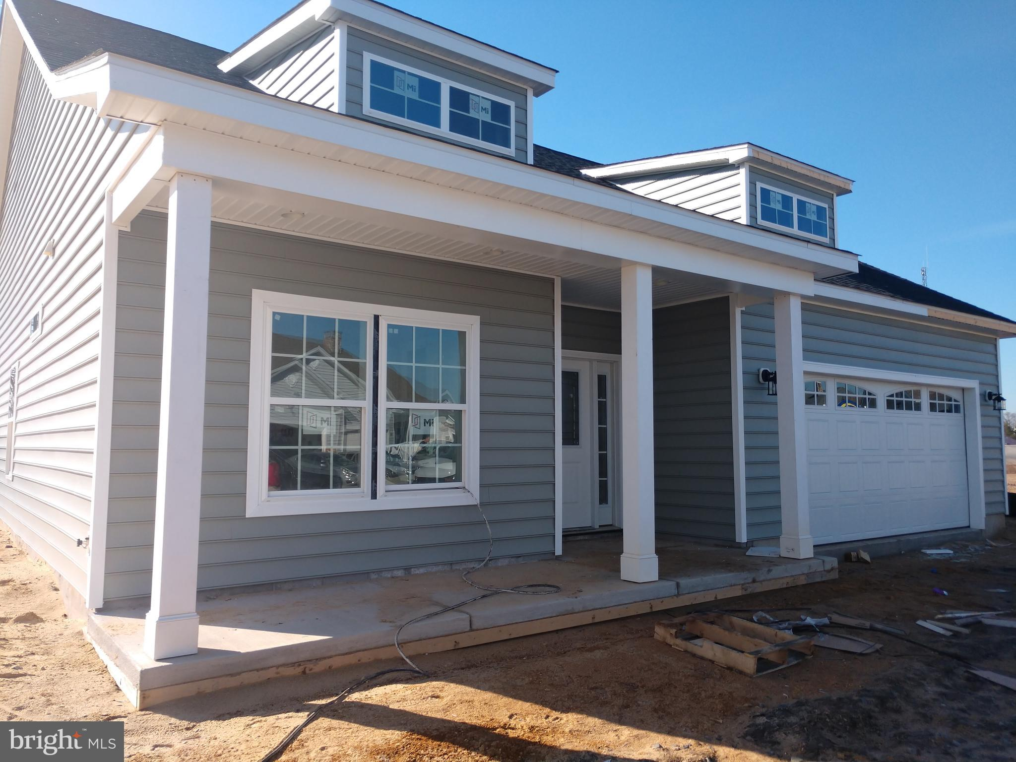 Currently under construction in the Village of Cinderberry is this 3 bedroom, 2 bathroom single fami