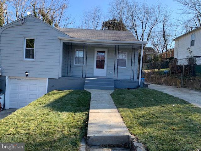 Completely renovated 4 bedroom 3 full bath single family home with garage and two driveways, feature