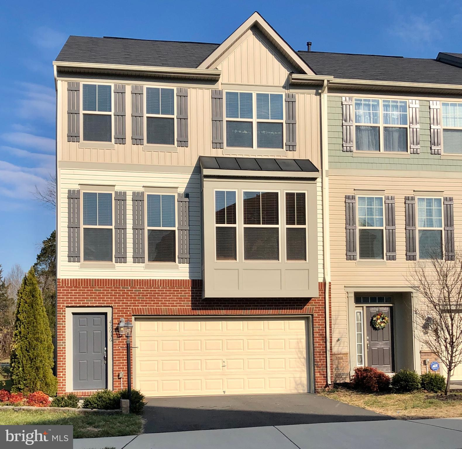 Gorgeous 4 BR, 3.5 BA End Unit TownHome with 2 car garage with 3 Level Extension in Great Location!