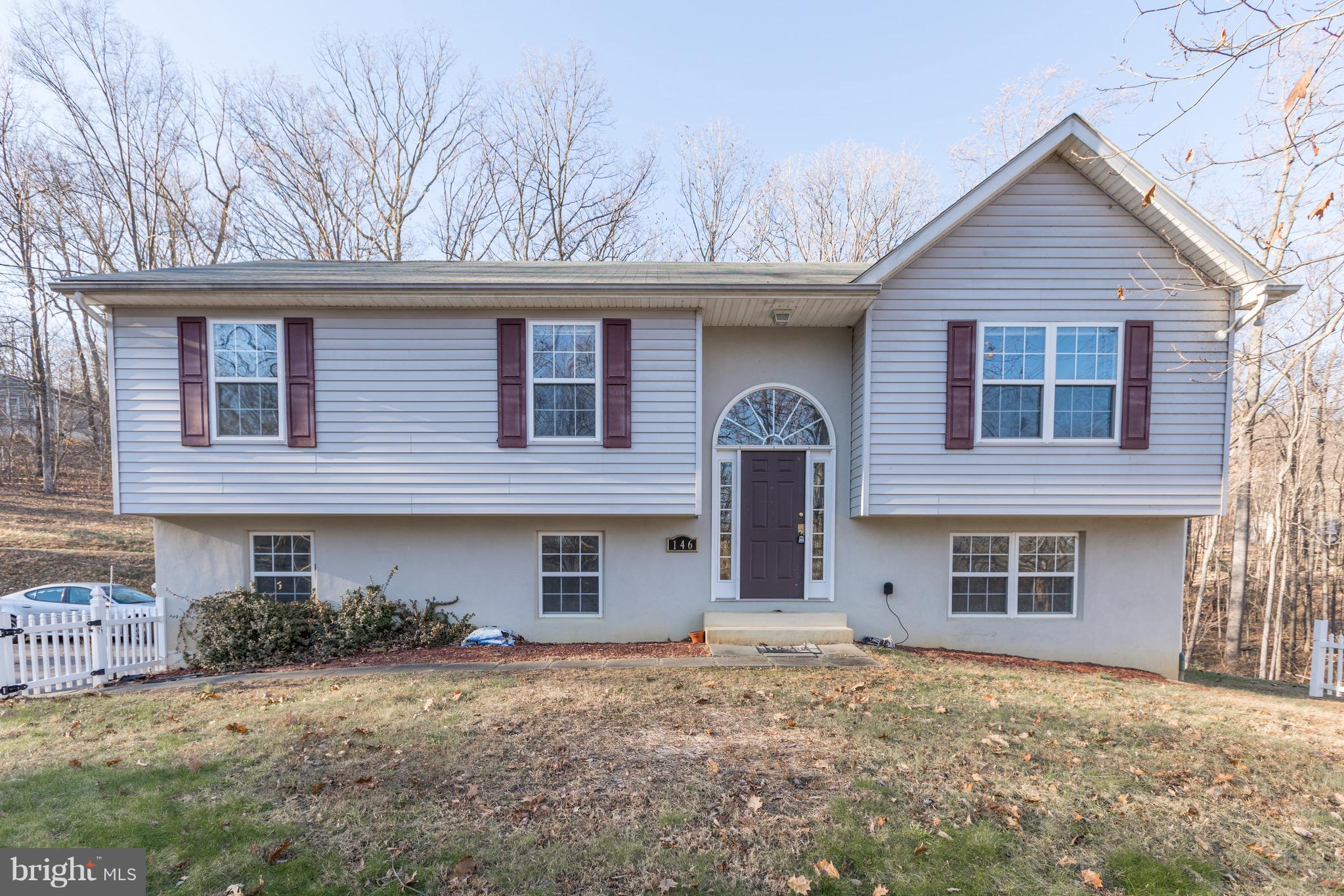 This spacious home situated on just over an acre surrounded by trees, makes for a quiet, comfortable