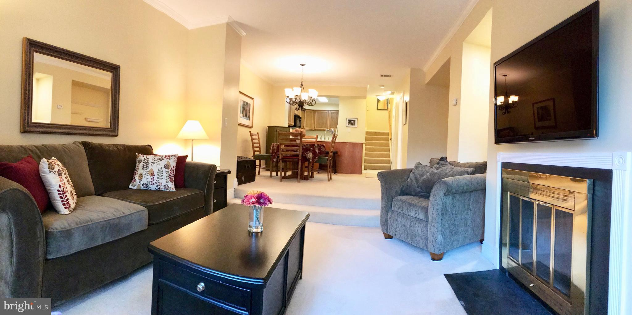 Move-in ready and conveniently located near everything! This ground-level, two-story condo located i