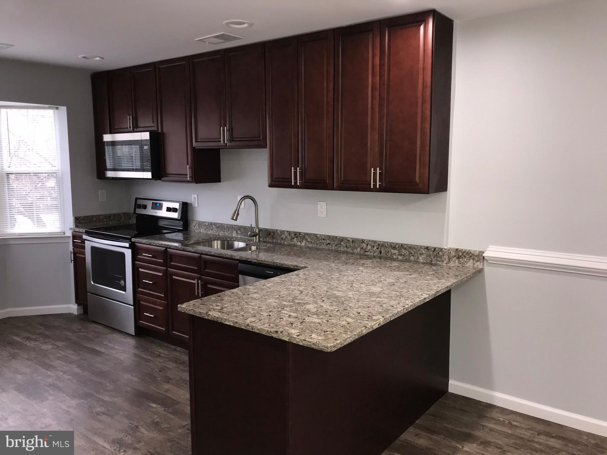 Renovated end Unit Townhouse in Laurel. This home features 3 spacious bedrooms and 2.5 bathrooms,  a