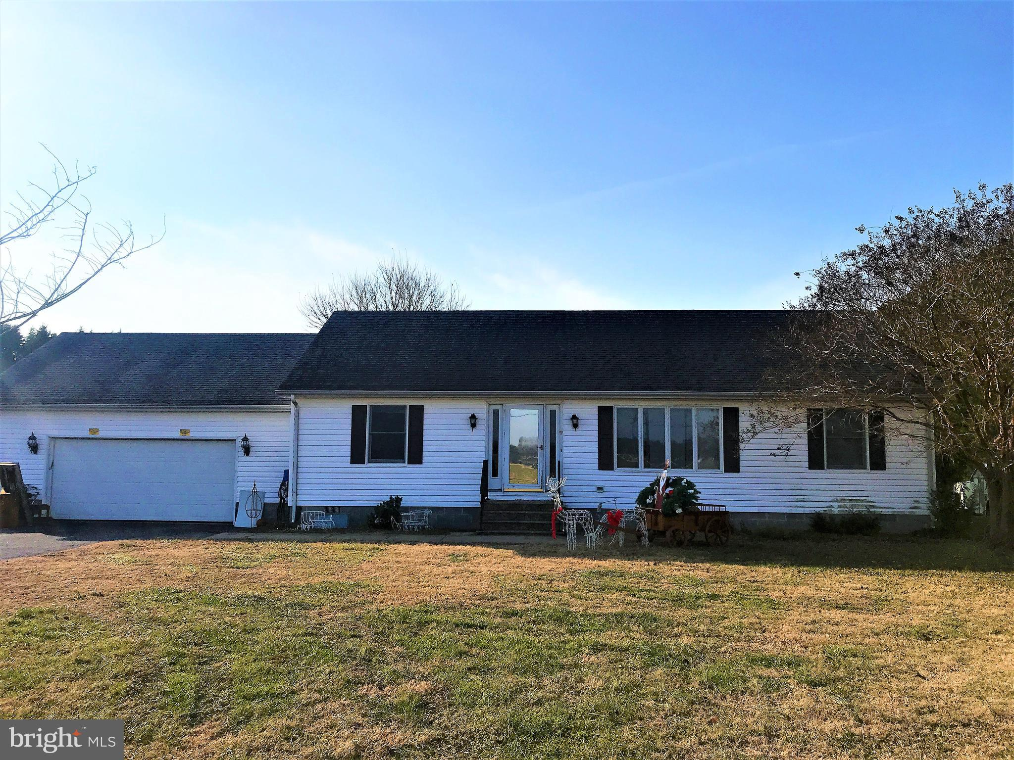 Nice 3 bedroom 2 bath rancher on 1 acre country lot!  Attached 2 car garage & detached 2 car pole bu