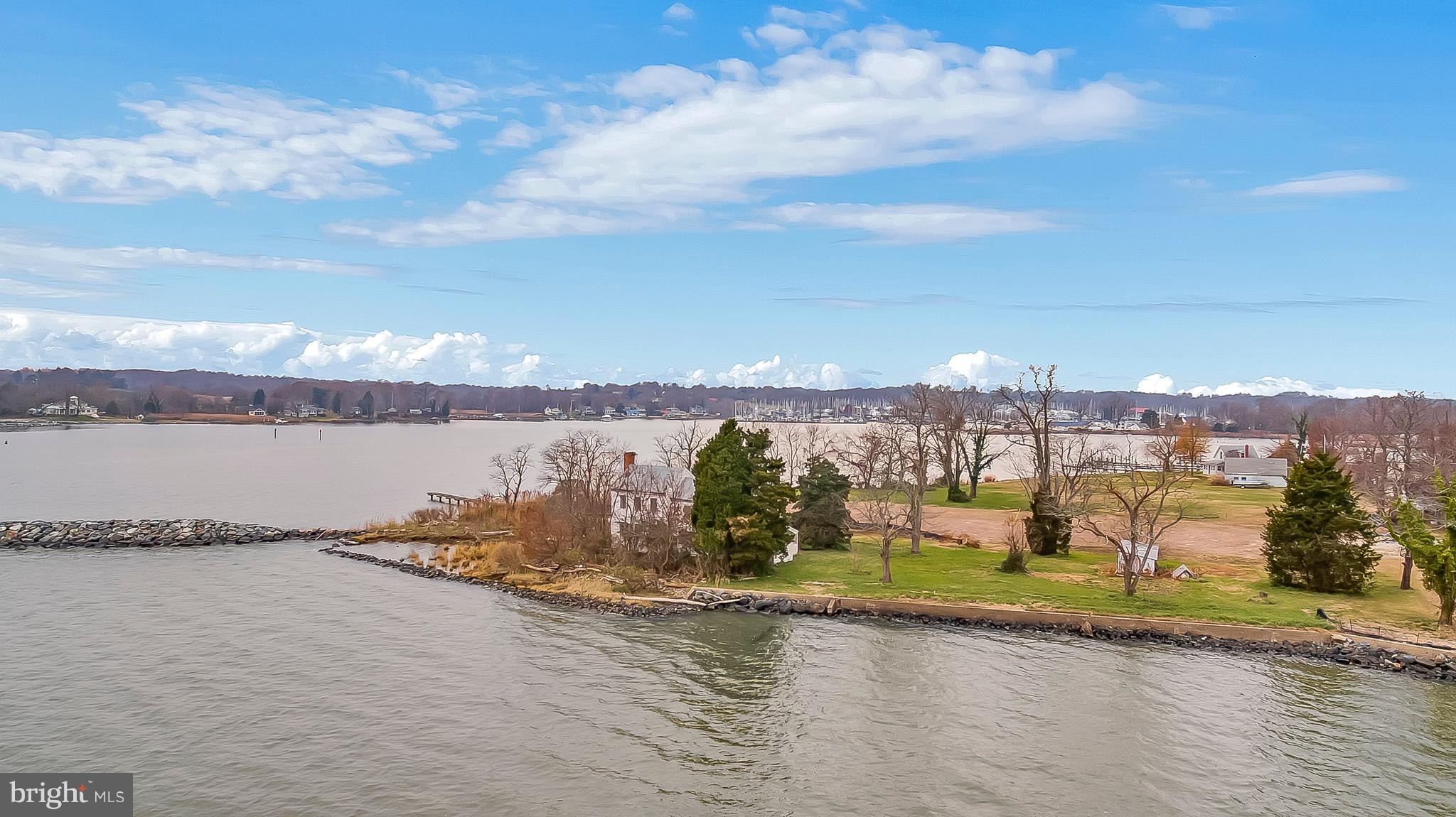 This amazing water front lot on the mouth of Rockhold Creek gives you breathtaking views of the bay