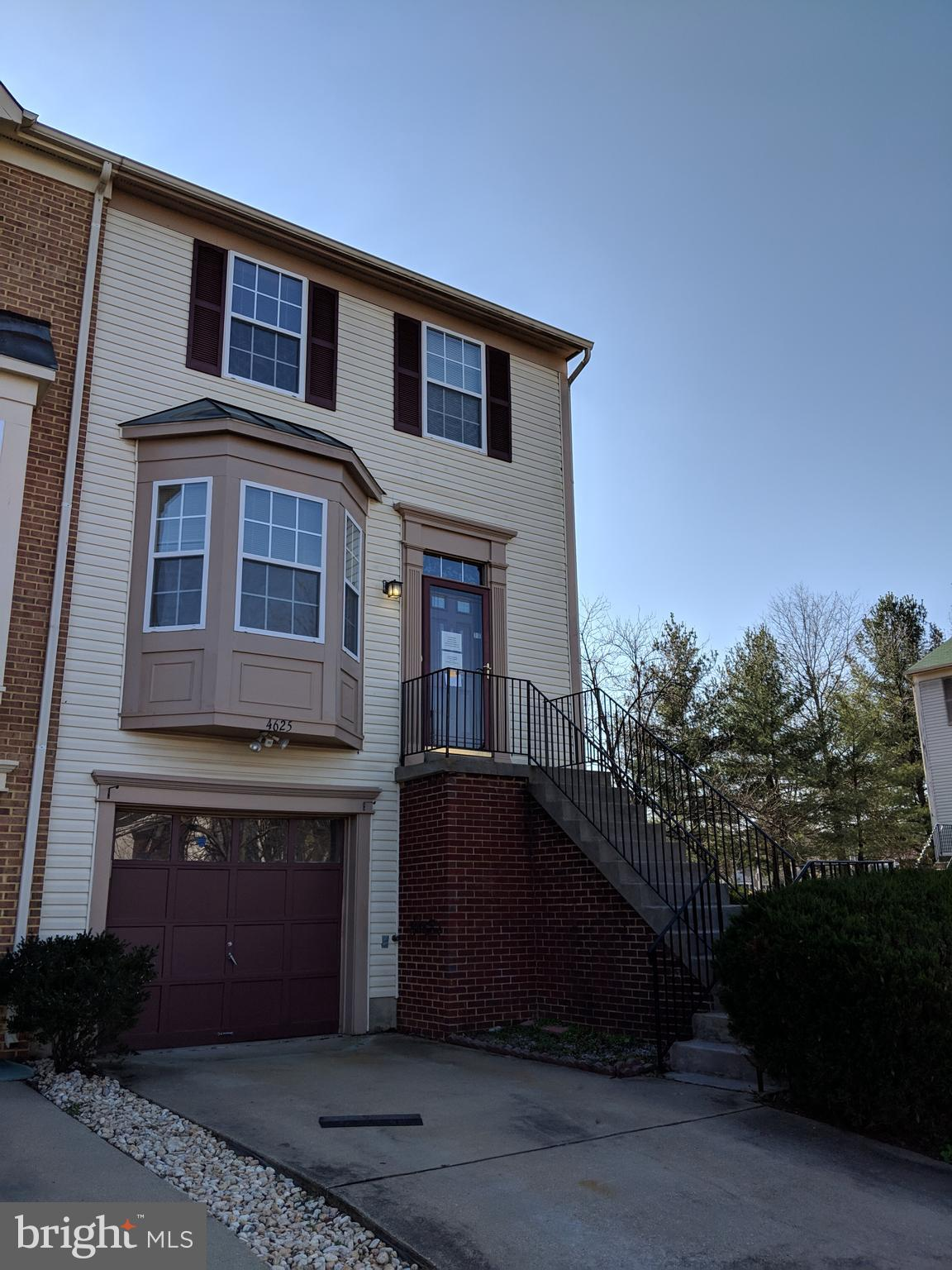Spacious end of group home in great condition with wood floors on first level, new appliances, fresh