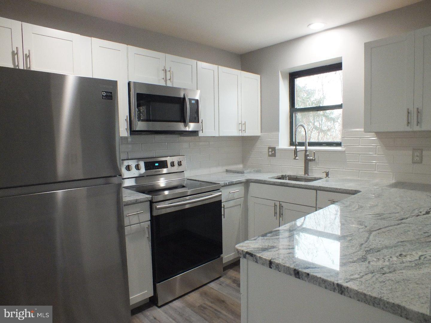 Completely renovated and move in ready 2 BR 2 Ba 2rd floor condo. Great new updates include all new