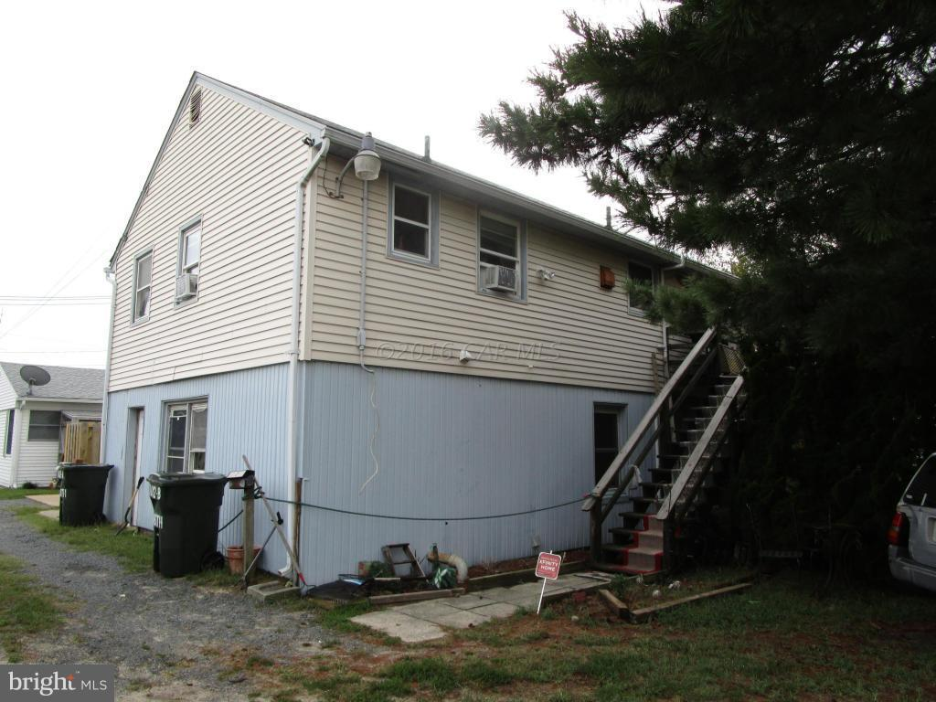 Investment opportunity.  2 Three Bed/1 Bath apartments, one up, one down.  Live in one unit and rent