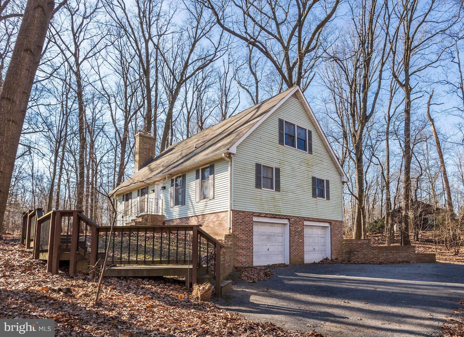 Gorgeous woodsy retreat on over 2 acres of land. This beautiful Cape Cod includes a 2nd non-buildabl