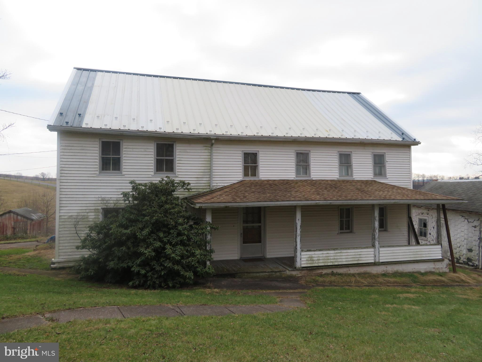 155 acres with a large 2-story, 5-bedroom farm house. Large L-shaped bank barn. 40' x 130' coverall building. Many other shops/garages, some of which are 20' x 34', 30' x 56', 22' x 30', 28' x 34', and a 36' x 72' heifer barn. Approximately 100 acres tillable, 40 acres of pasture, and 12 acres wooded. Small stream on the property with a beautiful setting, currently set up for beef cattle. Property is part of multiple parcels - taxes will be adjusted.