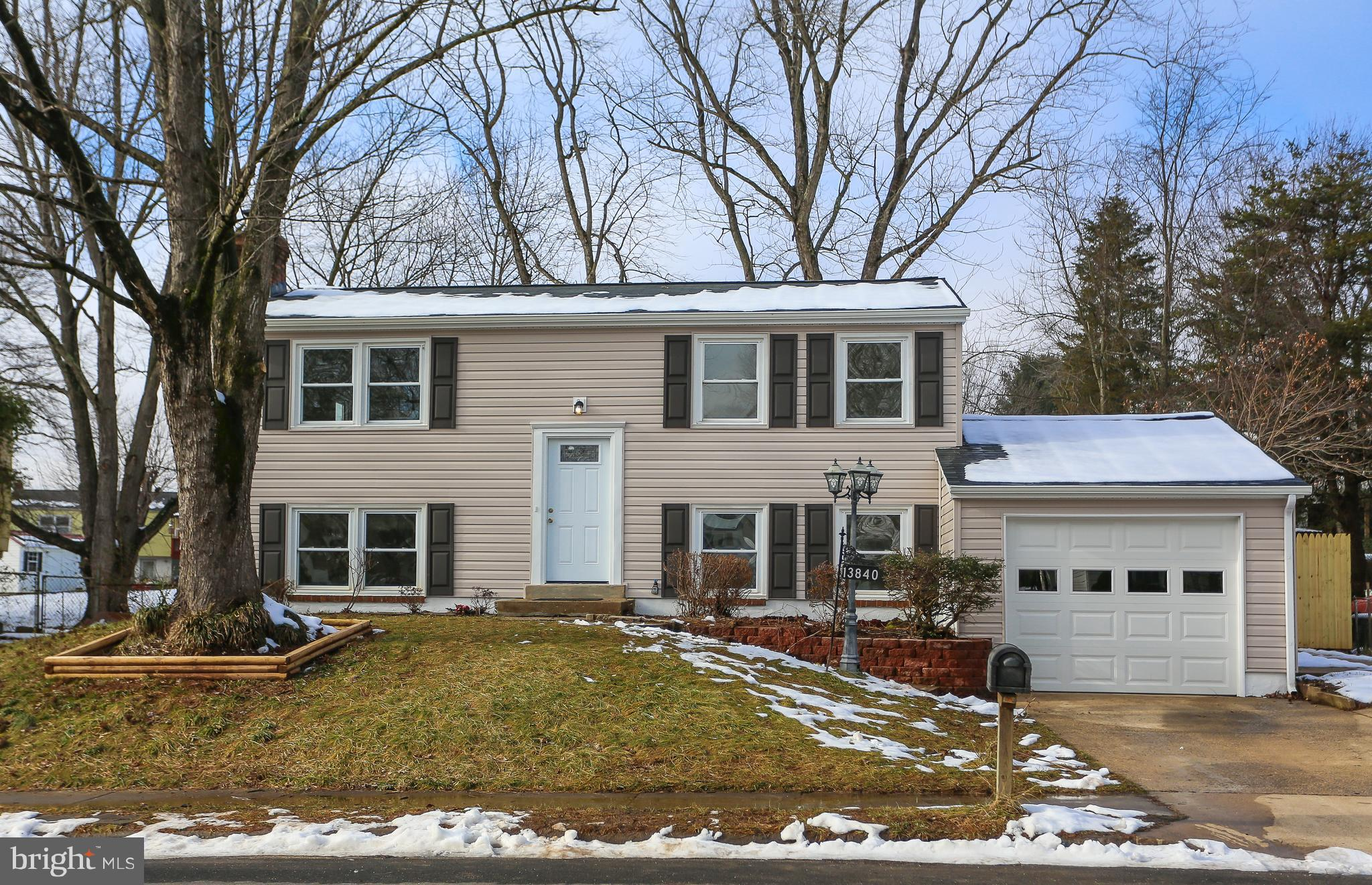 Completely renovated from top to bottom inc - All brand new, Roof, Siding, Gutters, Garage door,Elec