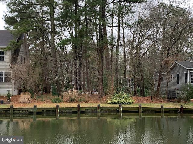 Wonderful Wooded Waterfront lot that is ready to build on now or hold for future plans. Close to pools and parks. Easy access to river, bay and ocean with no bridges. Owner financing available with credit approval. Call listing agent for details. Survey on file.
