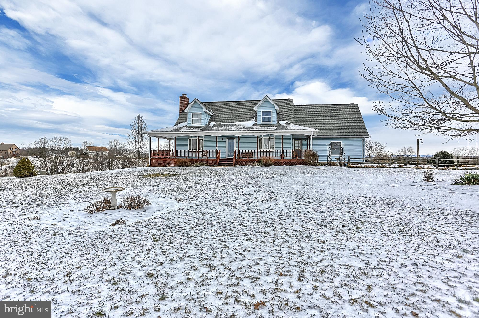 Room to spread out in this spacious Cape Cod on 2 acres with huge metal barn. Barn is 30x 56ft with